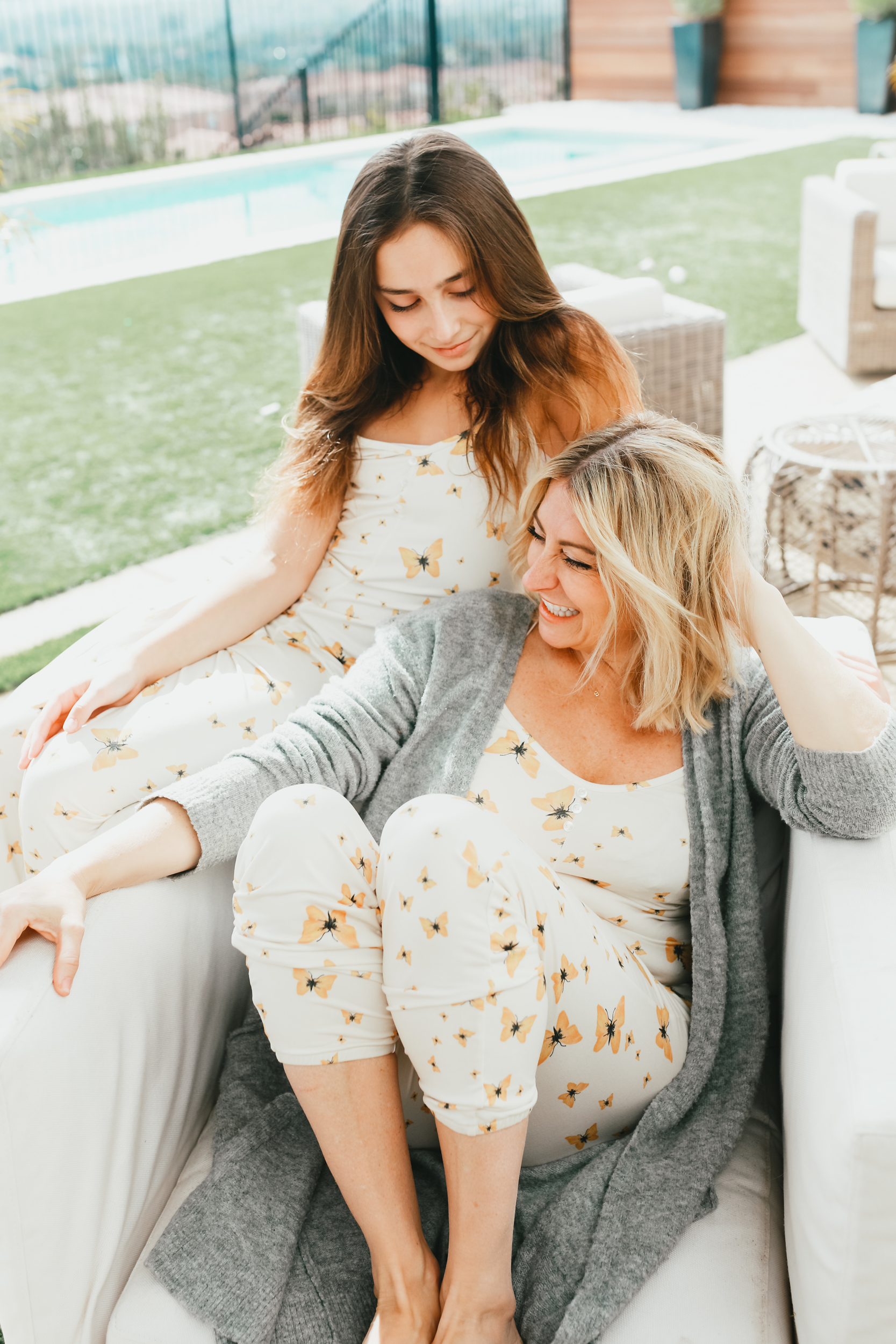mom and daughter sitting together