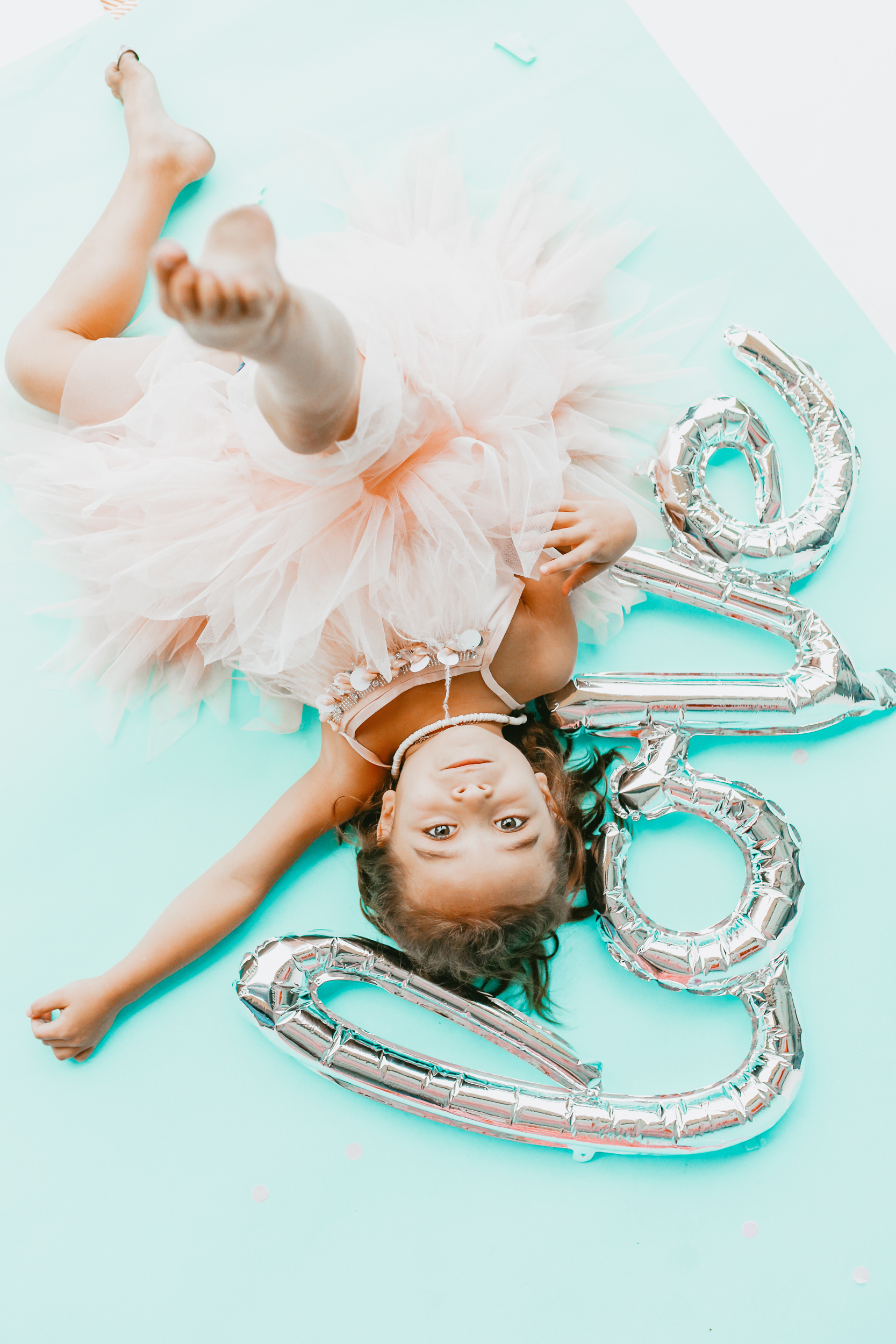 toddler with balloon and tutu