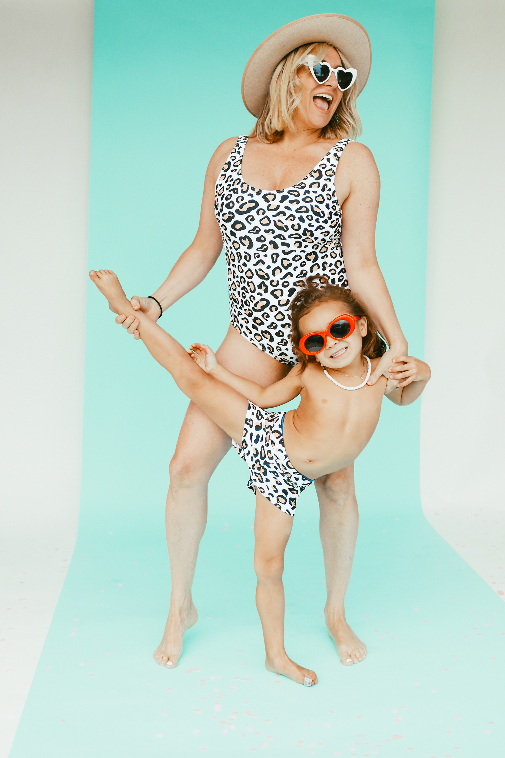 mom and toddler dancing in swimwear