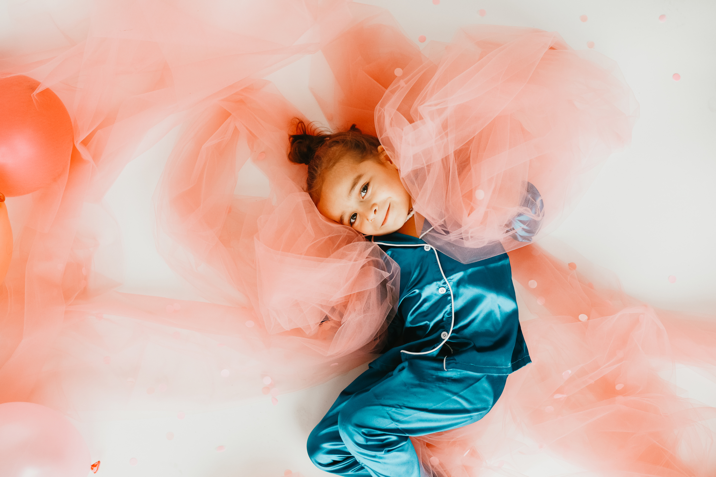 toddler playing in fabric