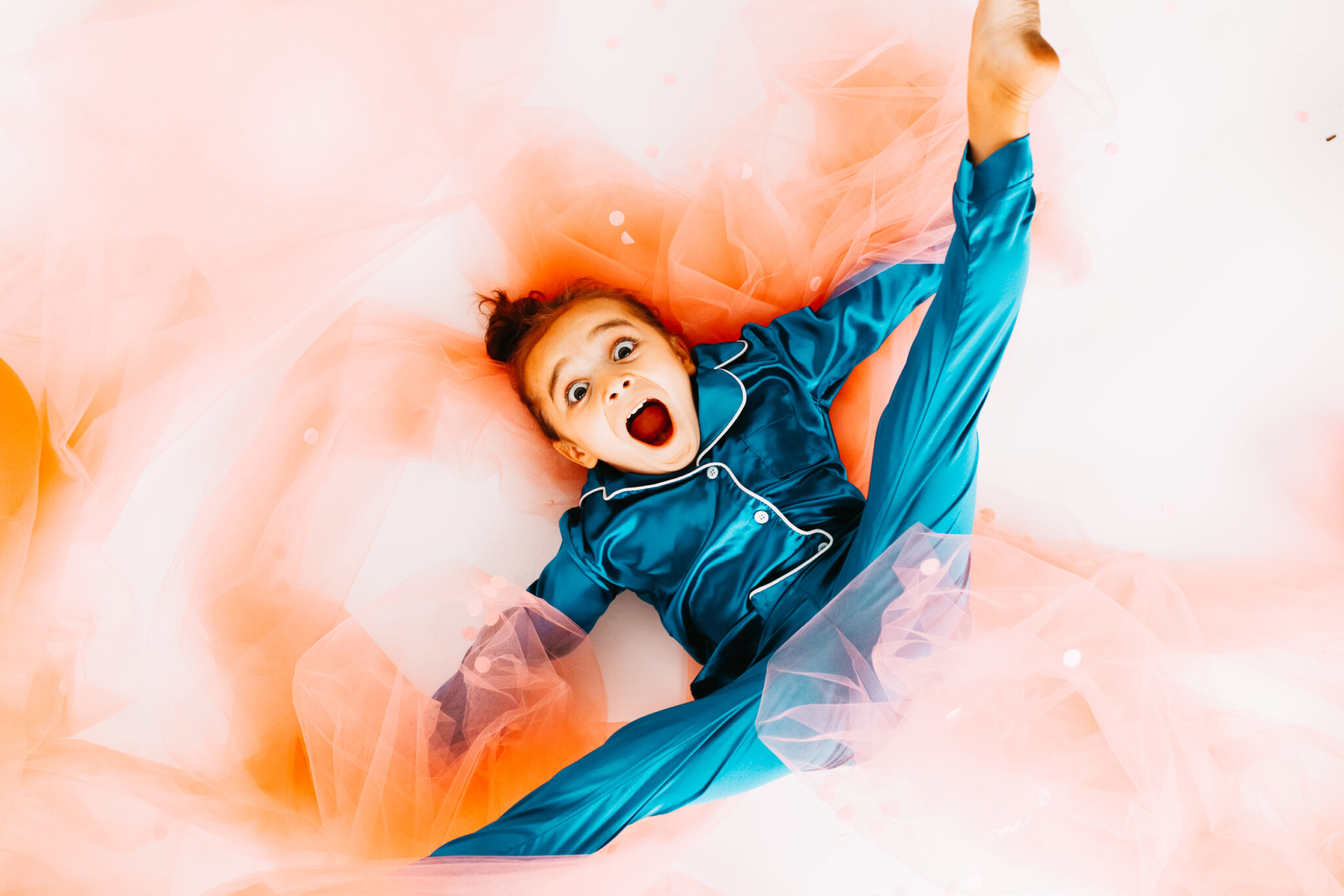 kid playing in tulle