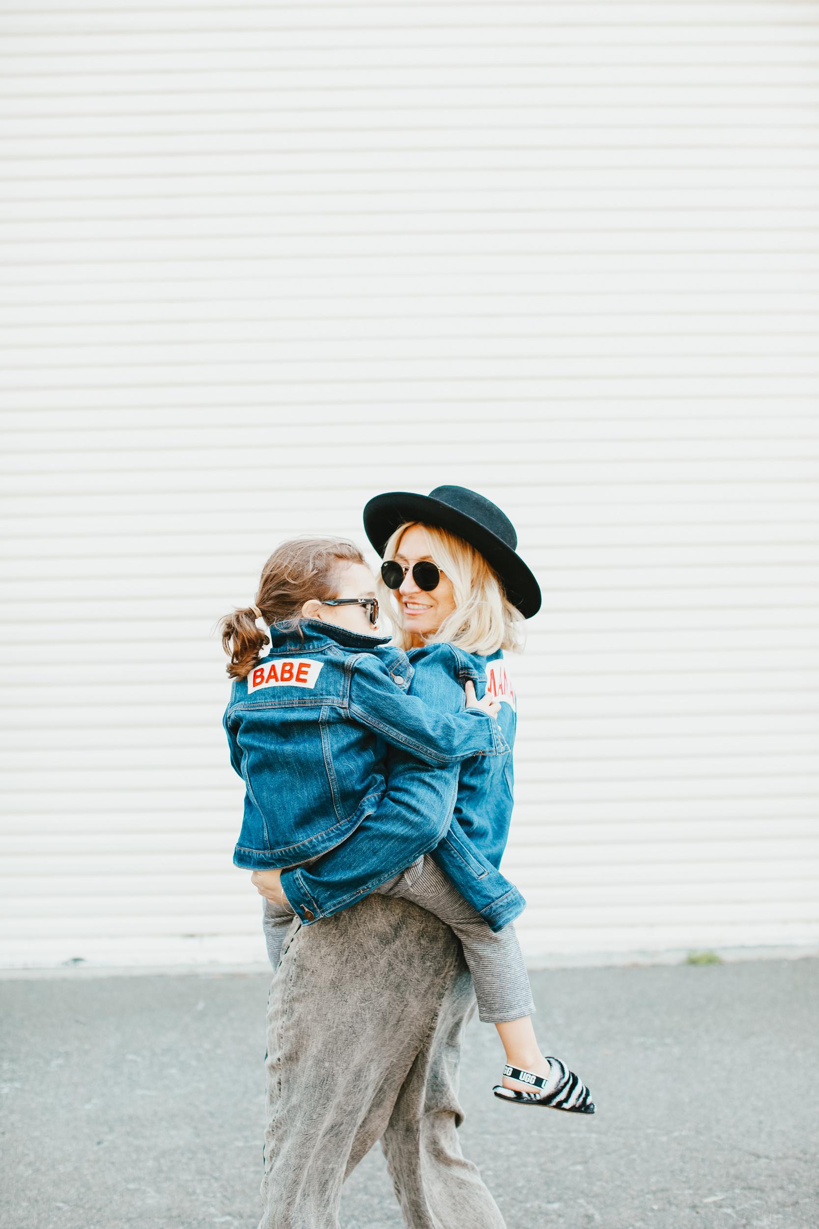 mom holding child