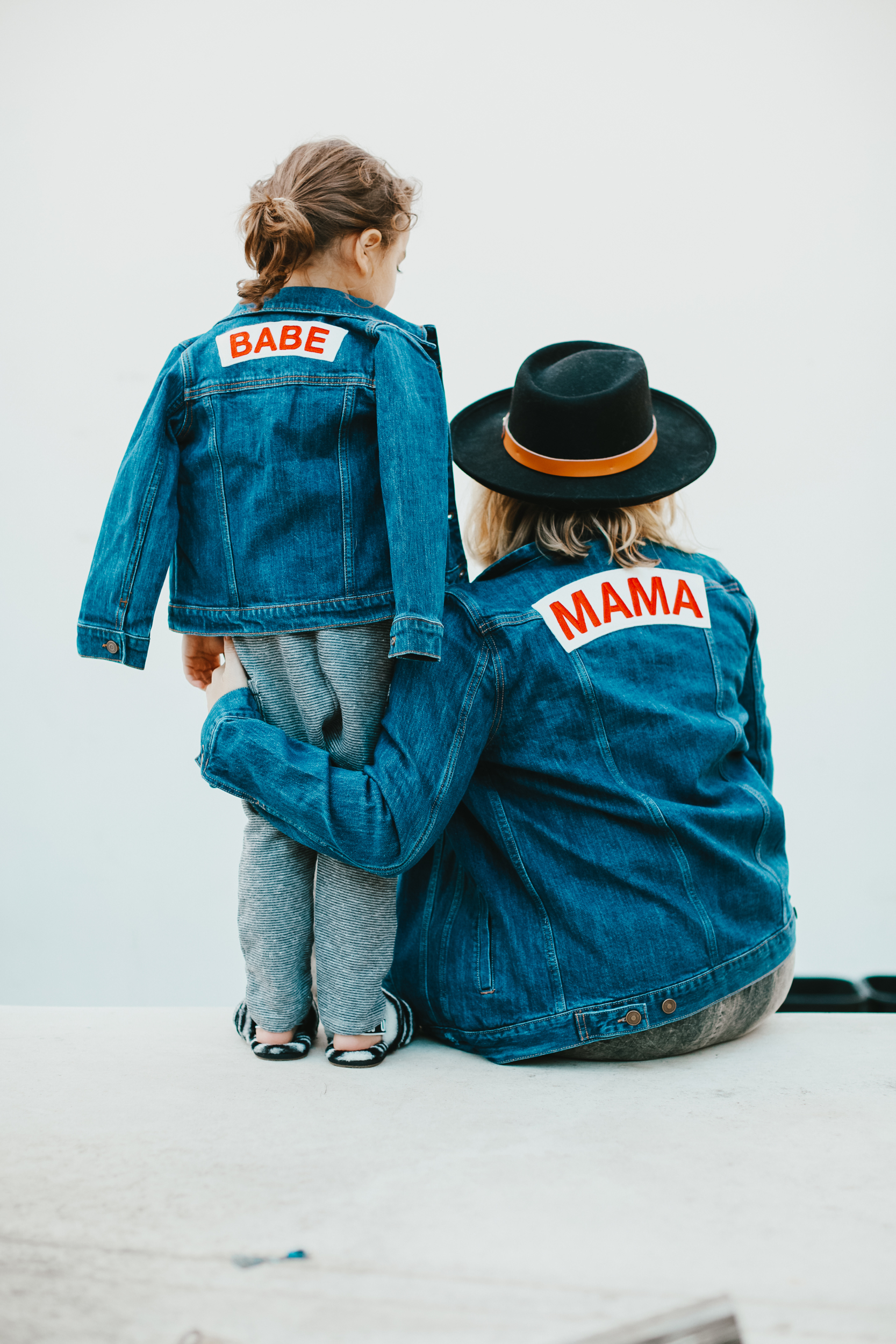 mom and son in matching jackets