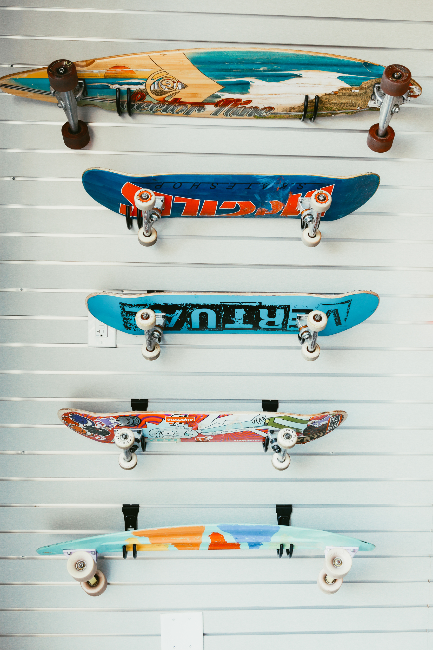 skateboards hanging on the wall