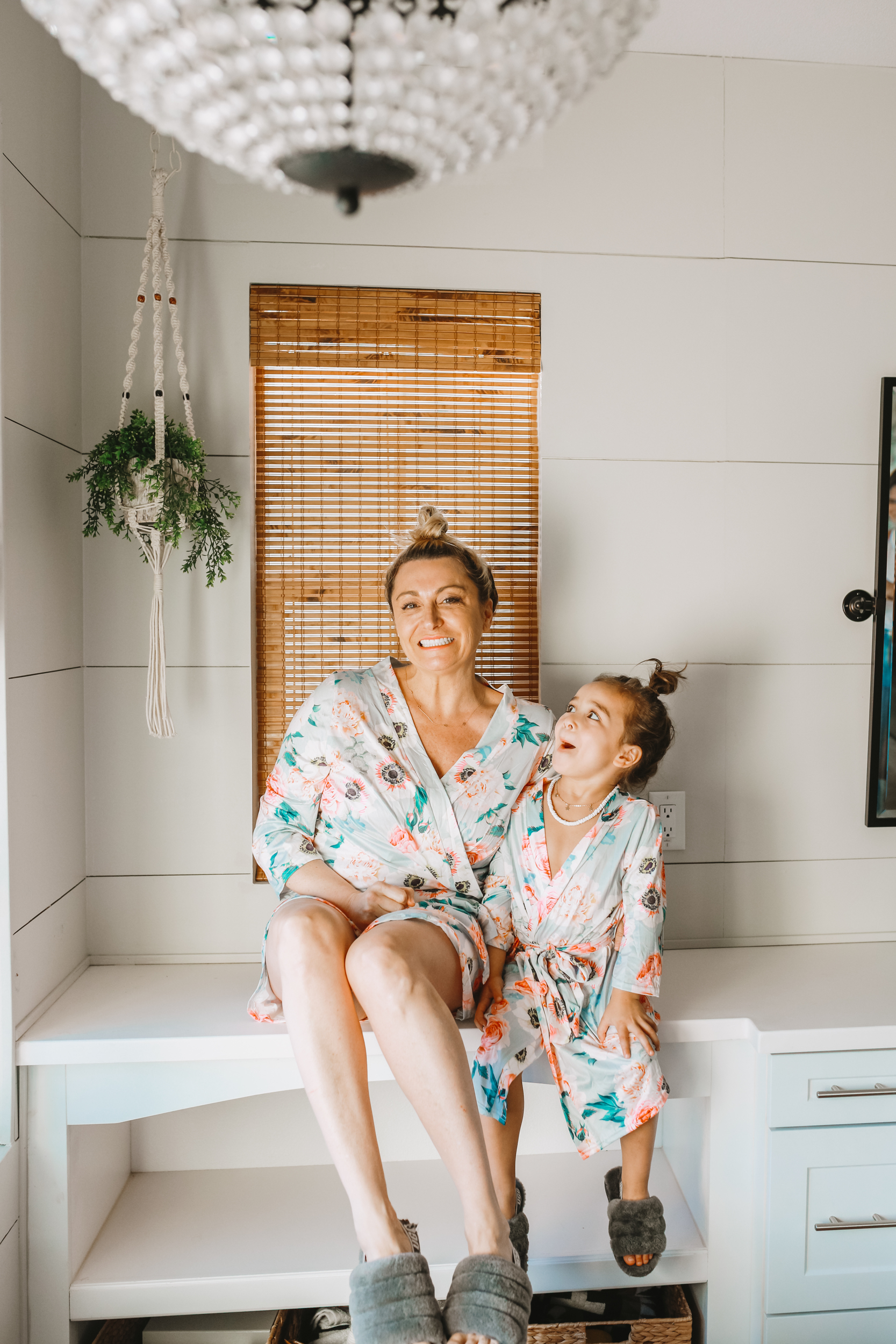 mom and son in matching bath robes
