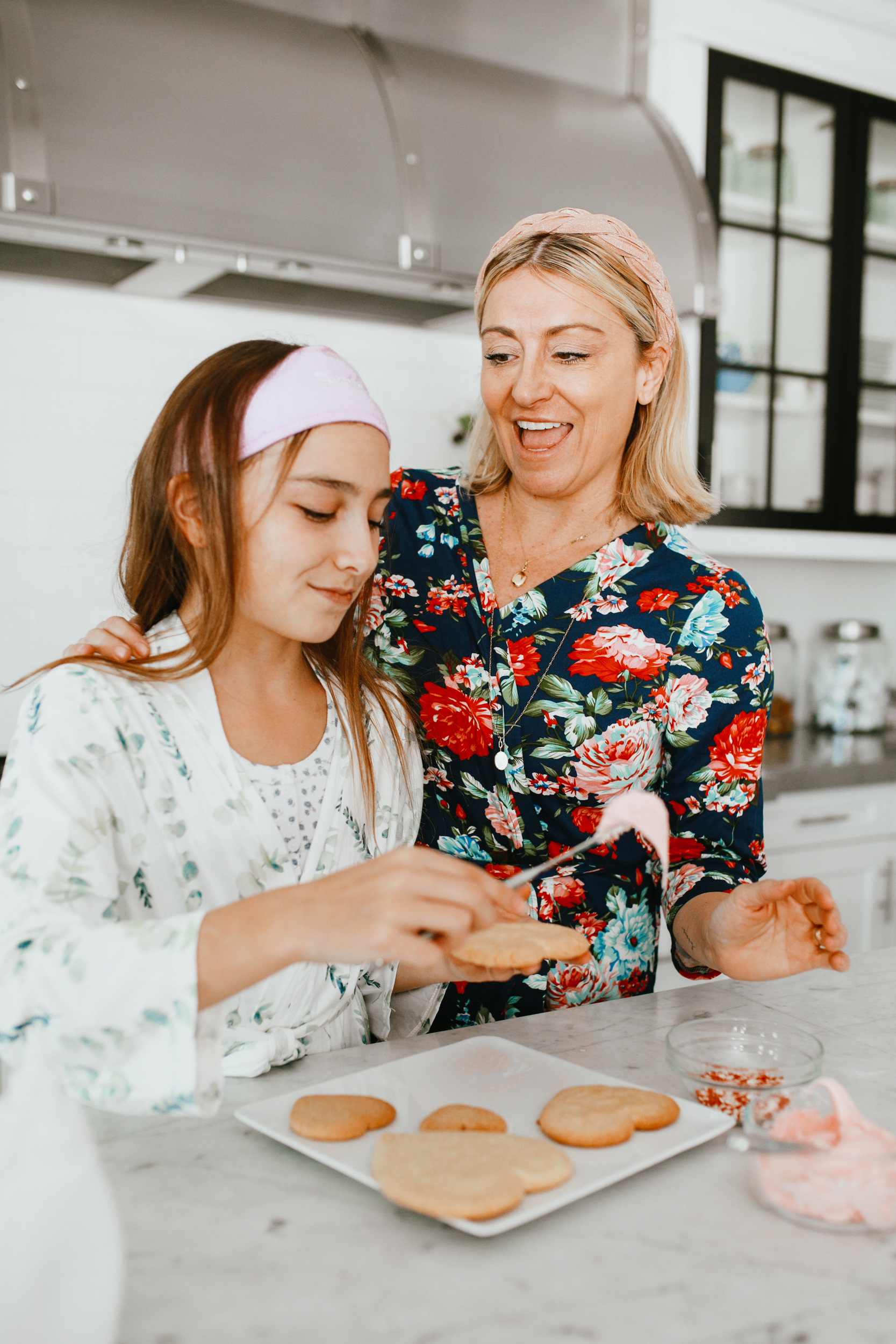 mom and daughter making cookies