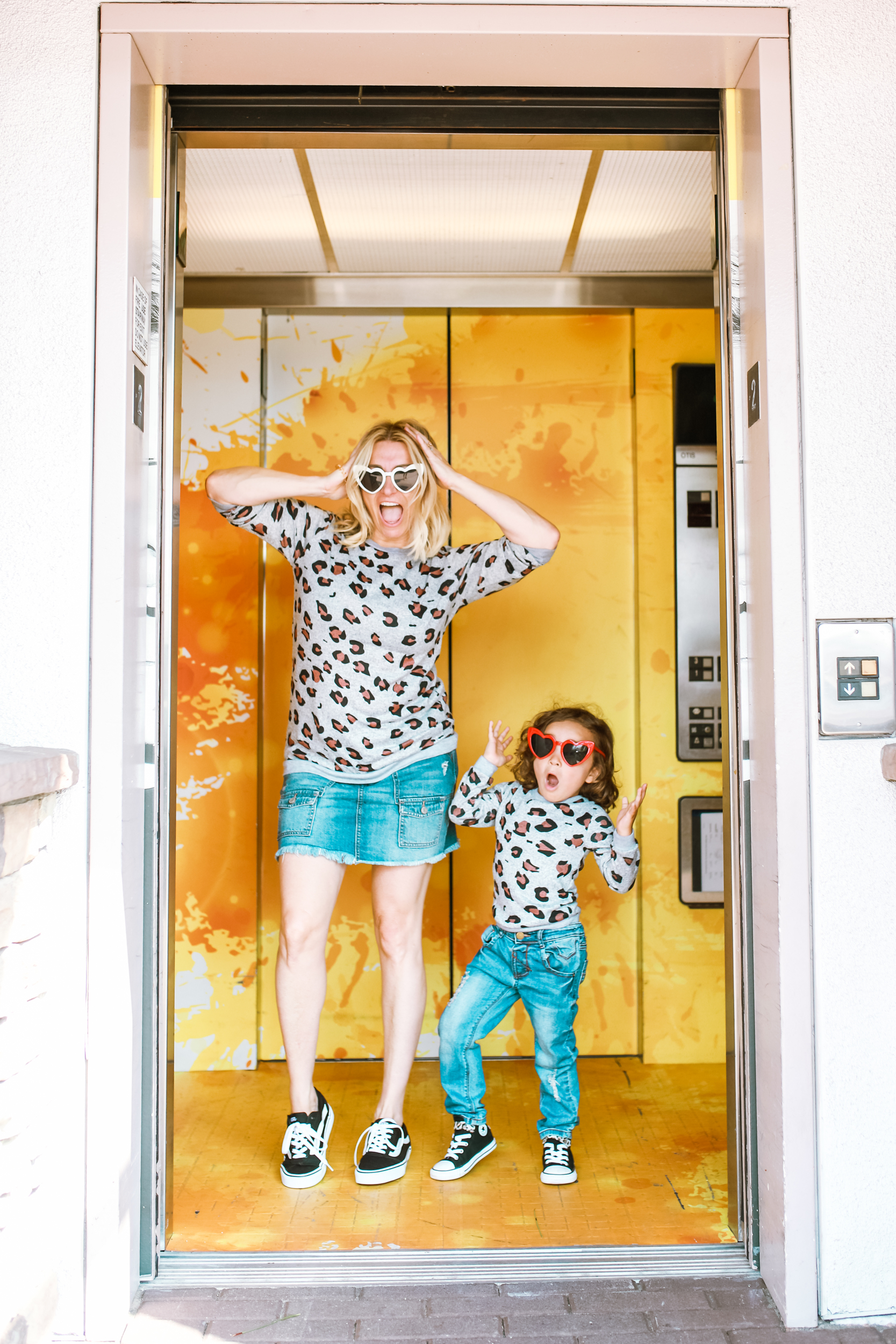 boy and mom posing in elevator