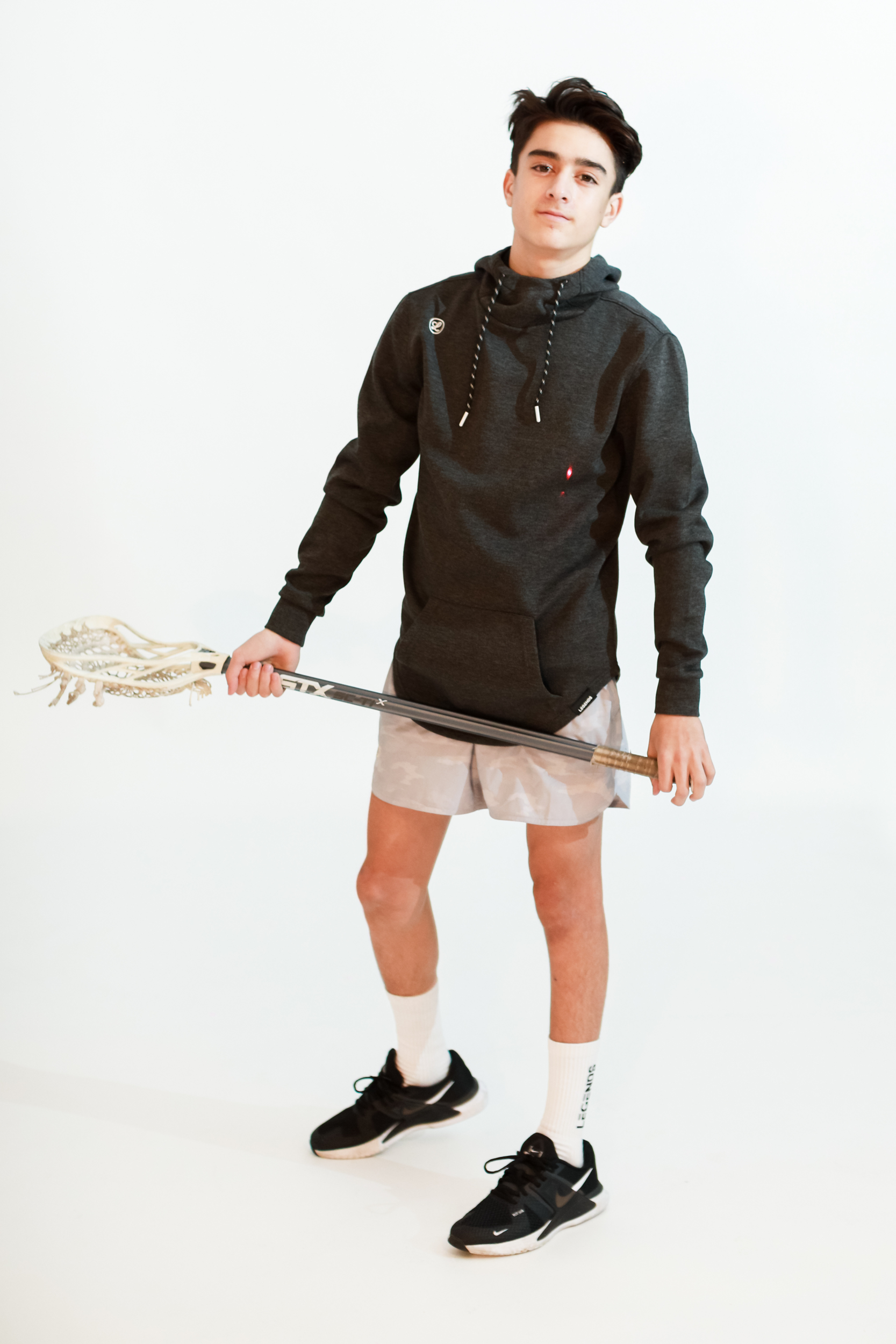 boy in lacrosse gear