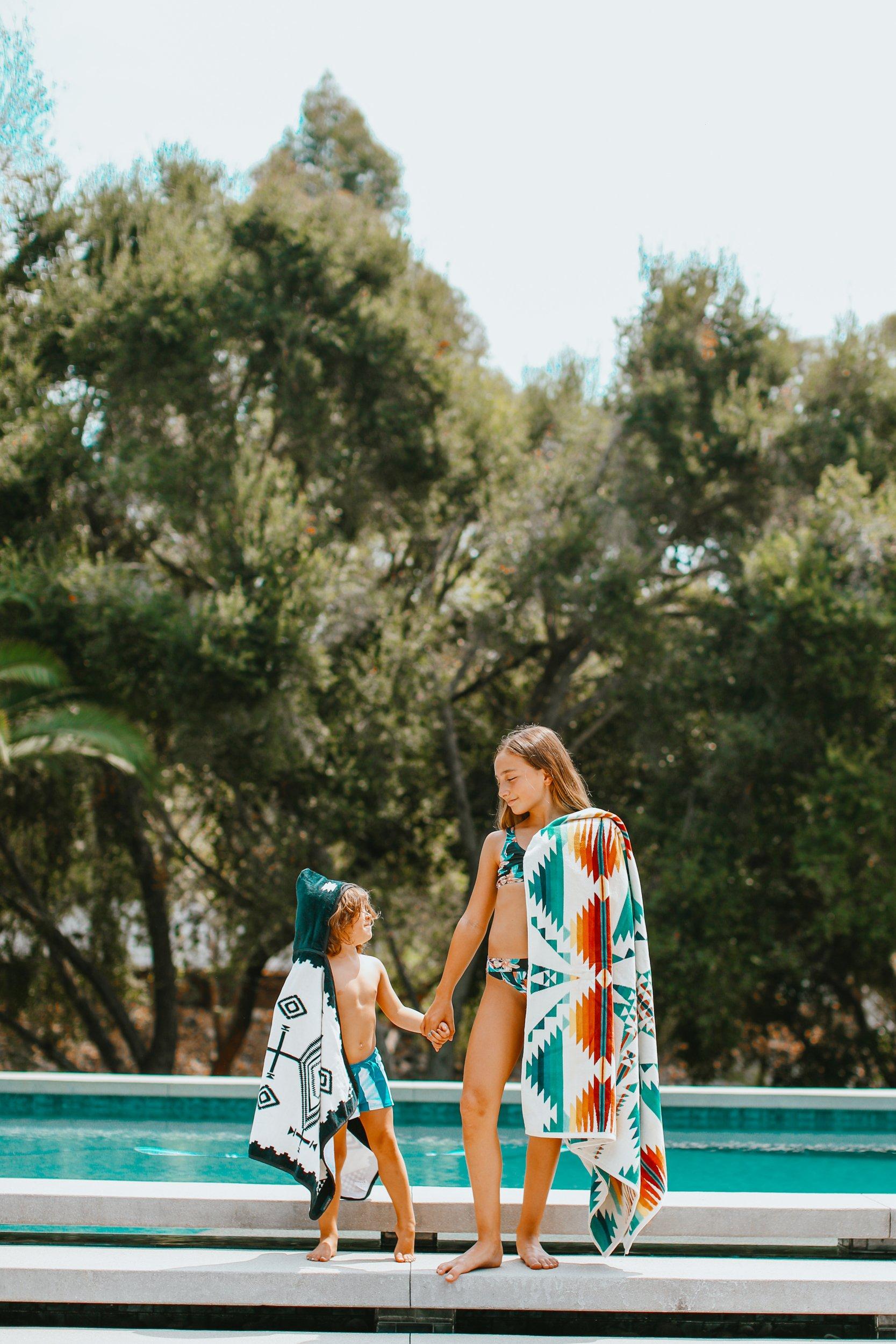 siblings by pool