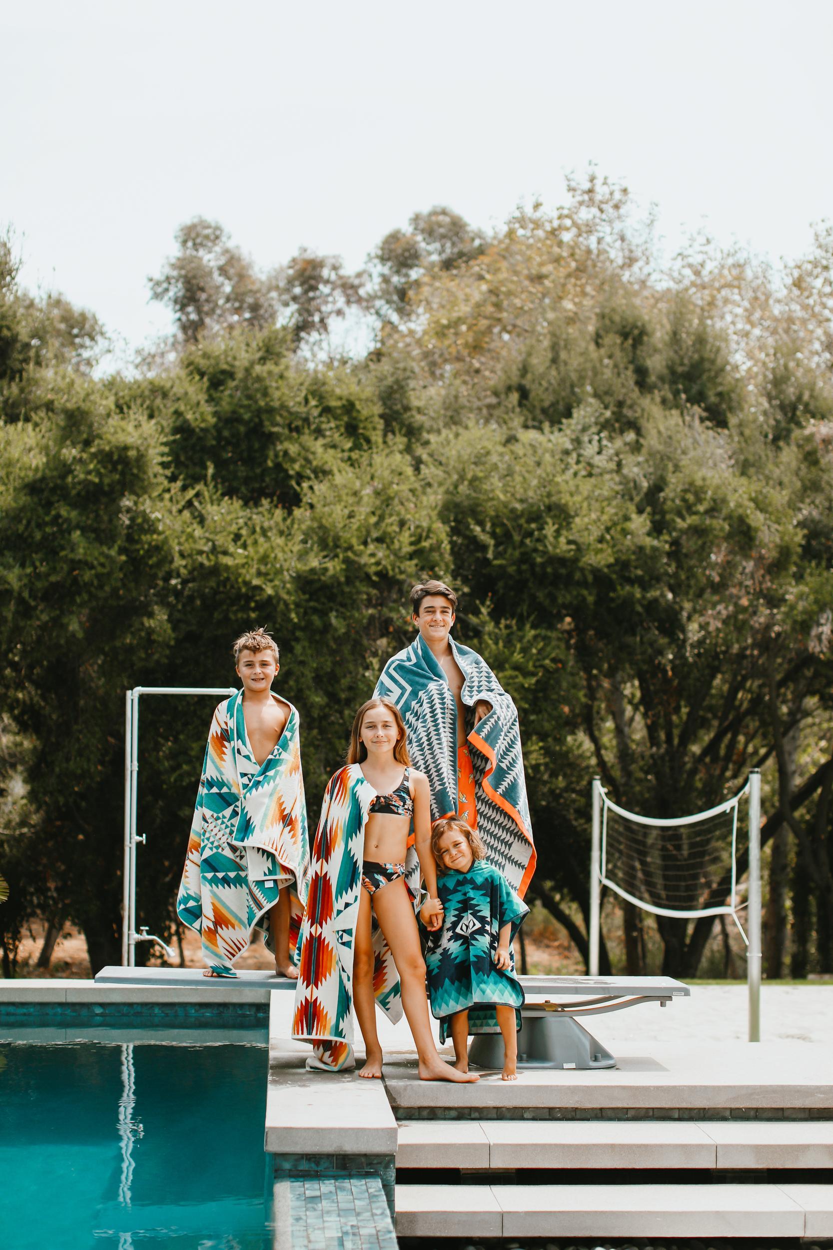 kids standing around the pool