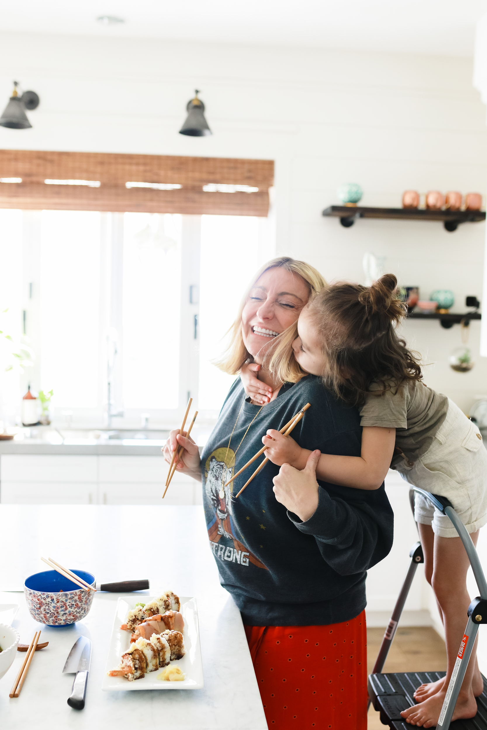 mom and child hugging in kitchen