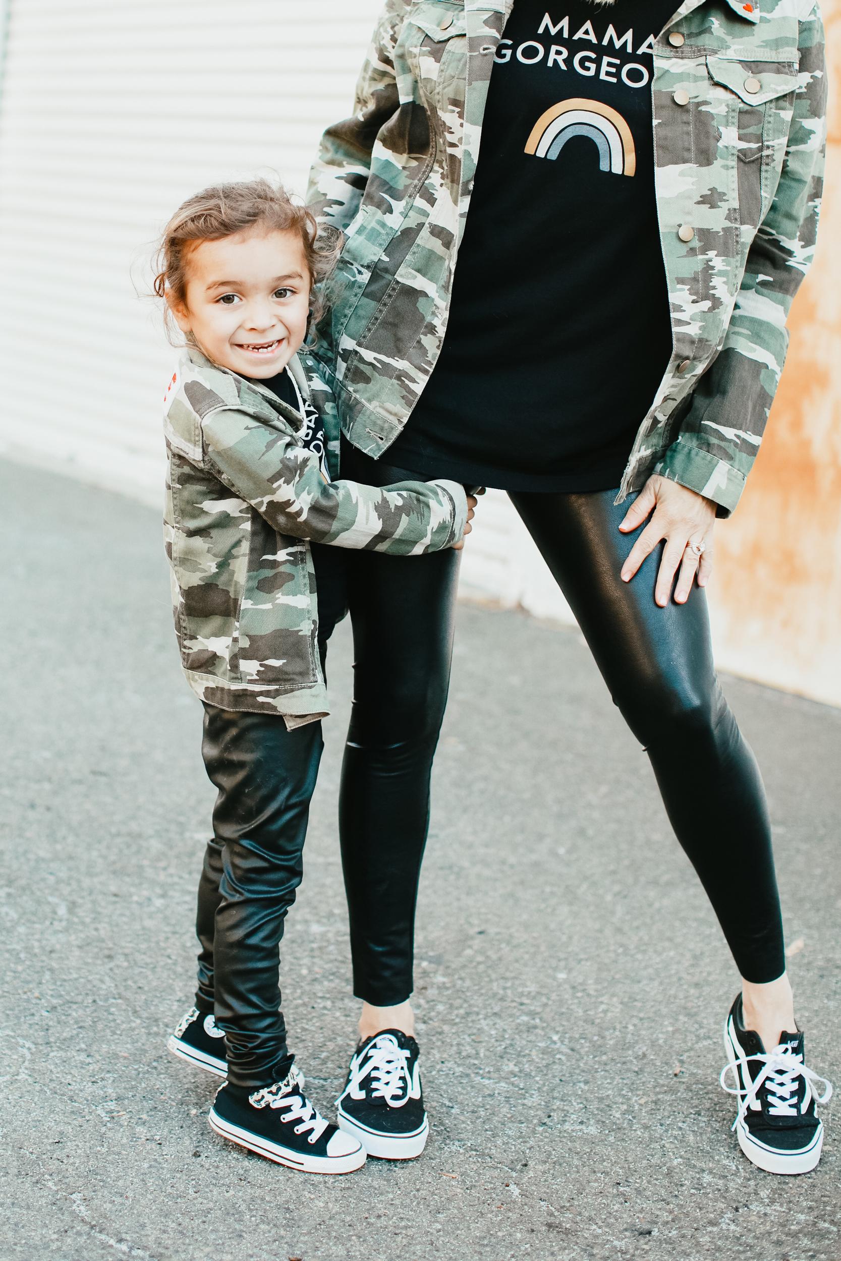 kid holding onto mom