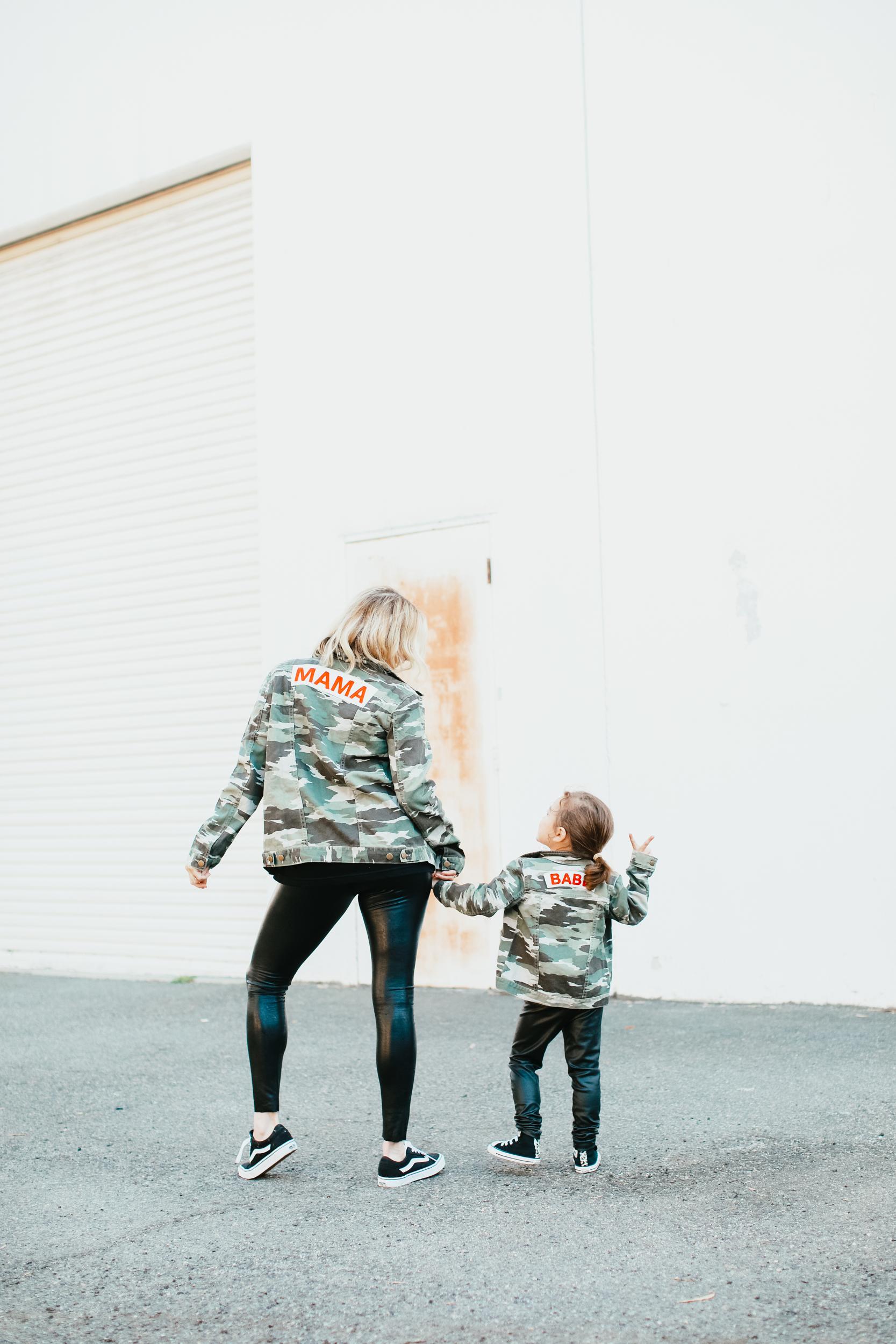 stylish mom and kid posing