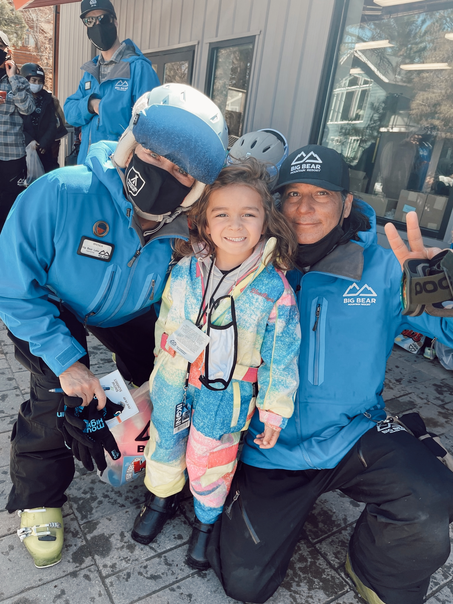kid with ski instructor