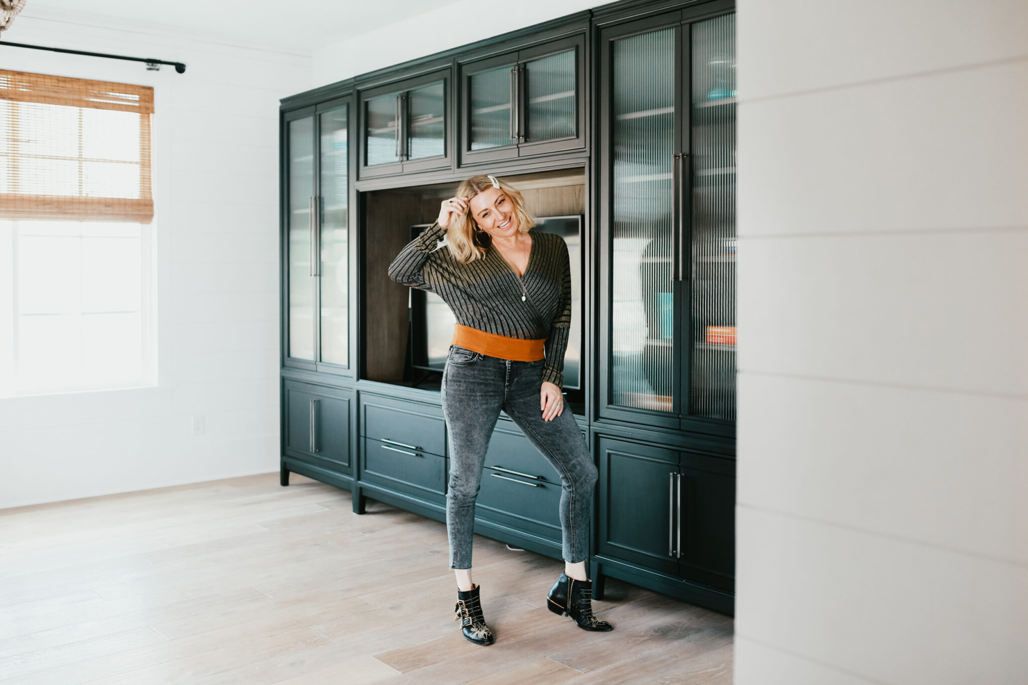 stylish woman standing in room
