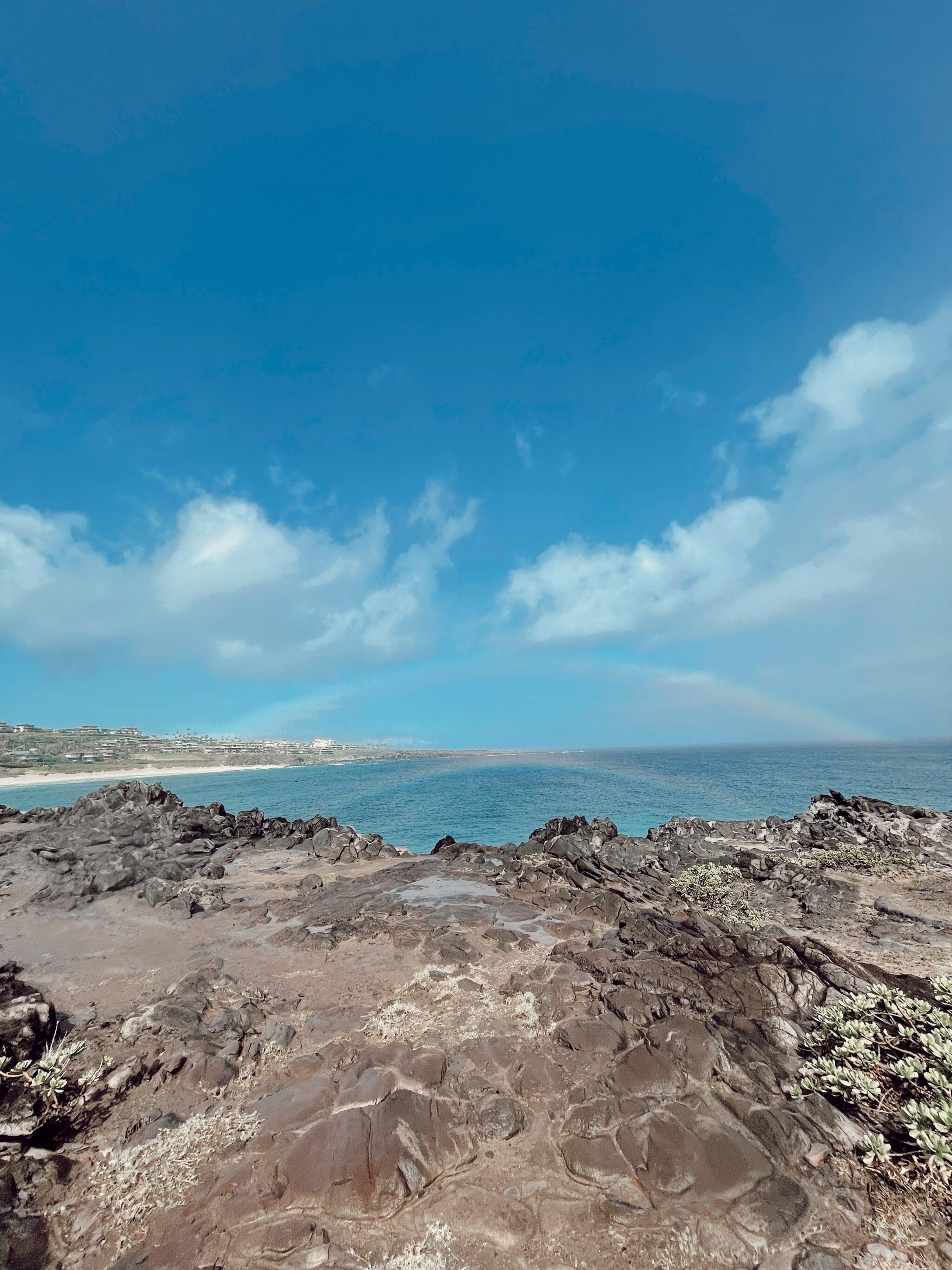 beach rainbow in hawaii