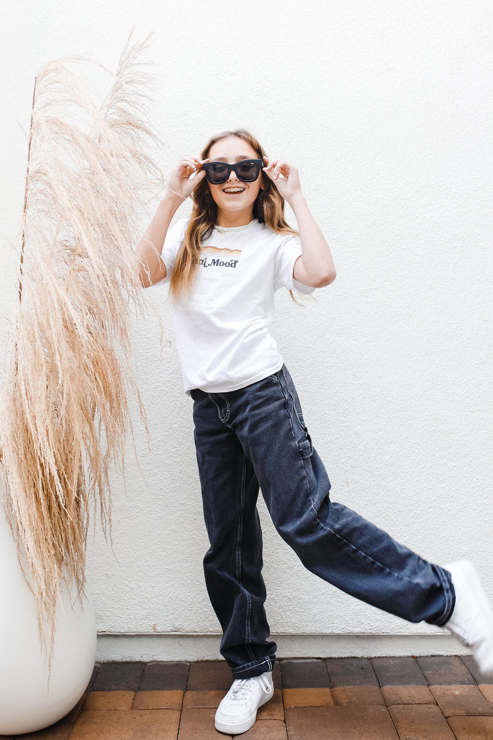 girl in sunglasses dancing