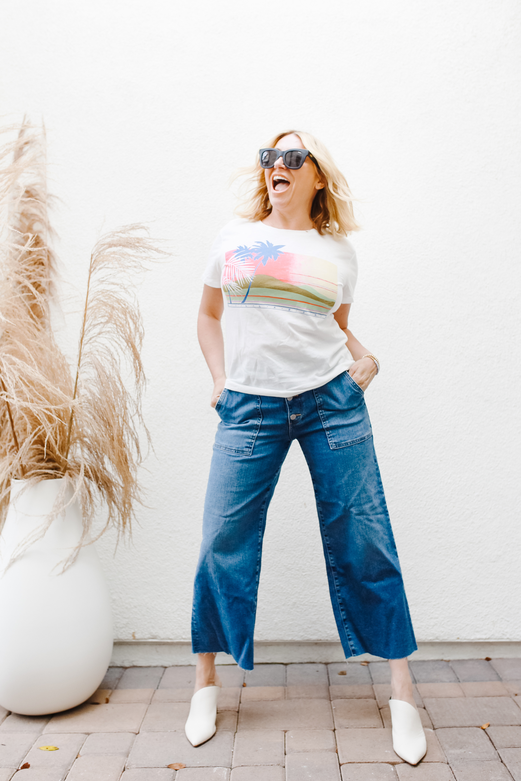 happy woman in jeans and tee