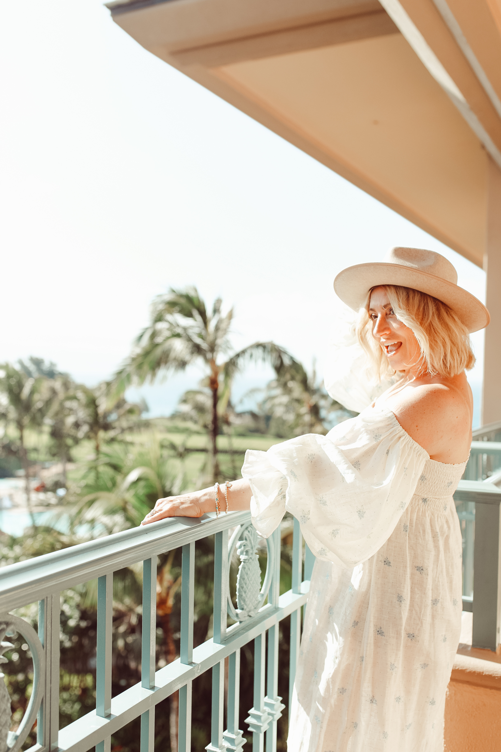 woman looking out over balcony