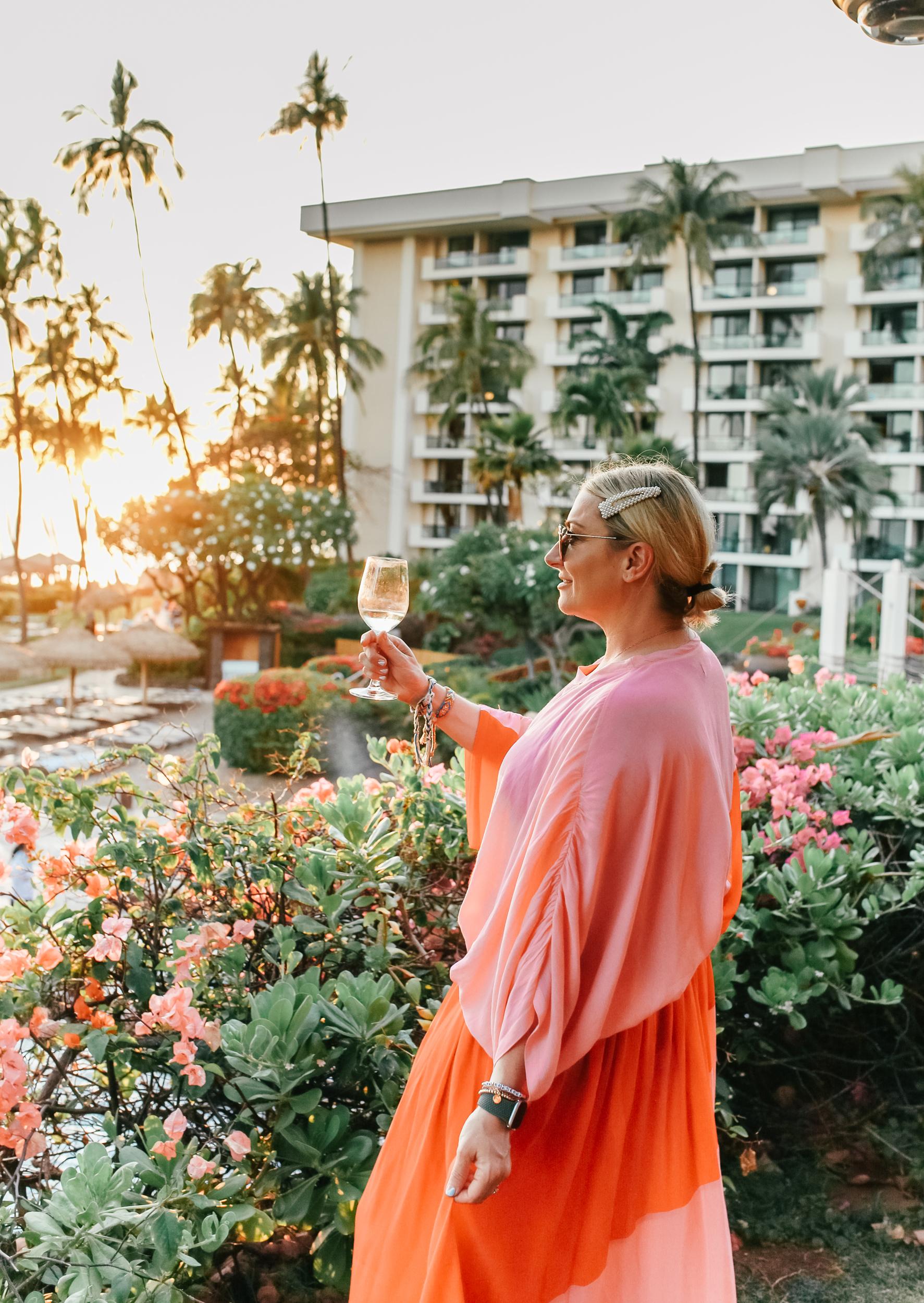 woman toasting in hawaii