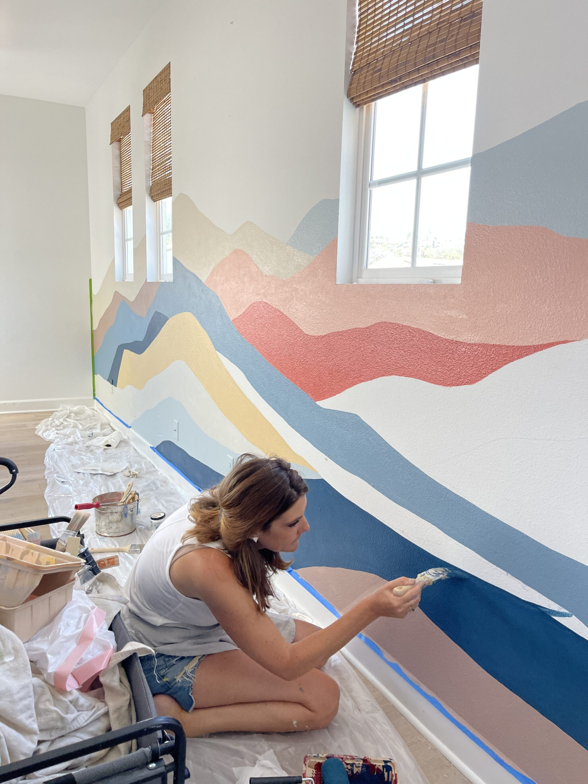 woman painting a wall