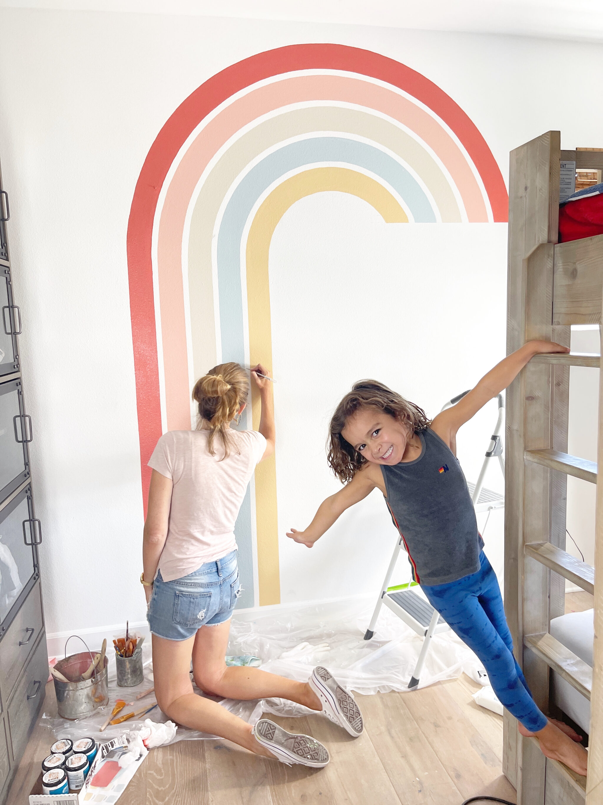 happy kid with woman painting
