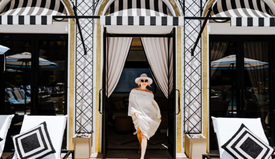 woman walking out of cabana