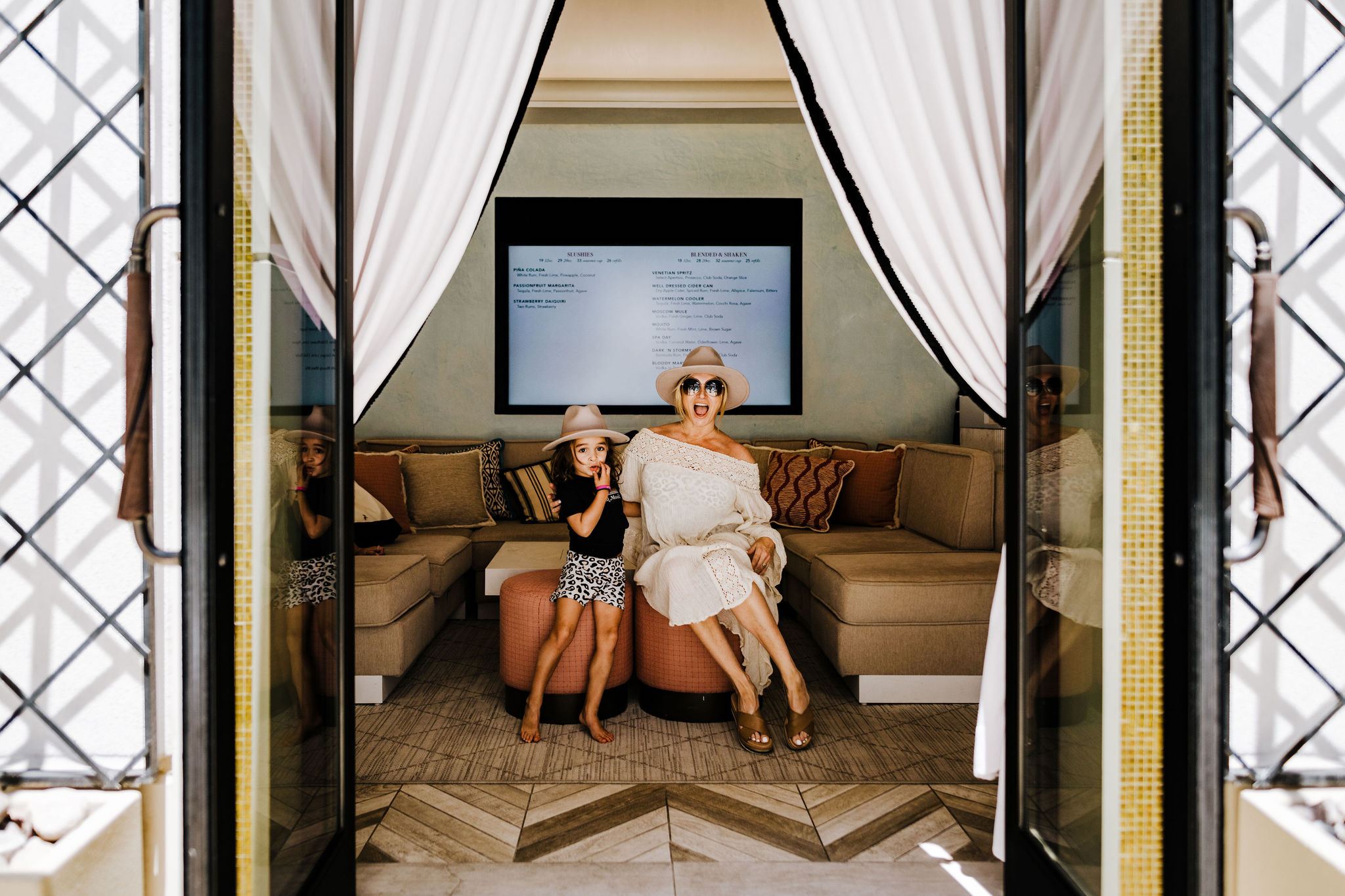 mom and child in pool cabana