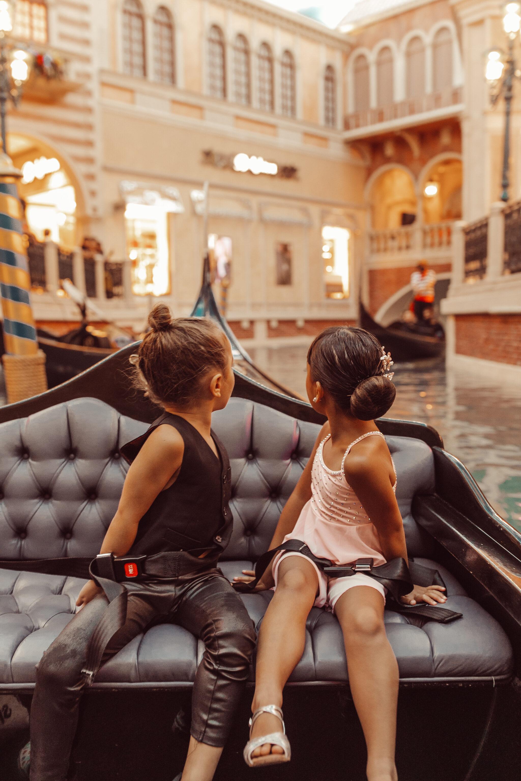 kids on venetian gondola