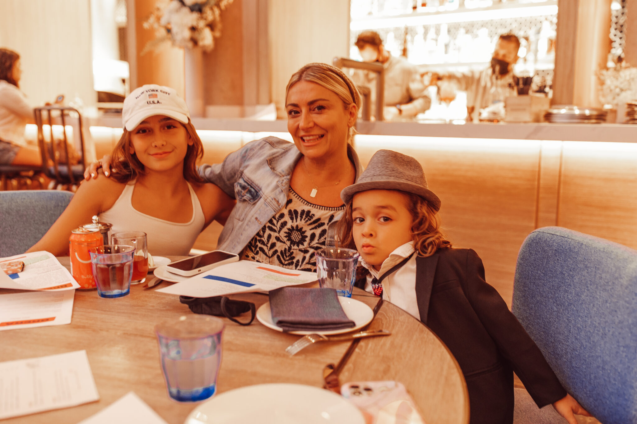 mom with kids at restaurant