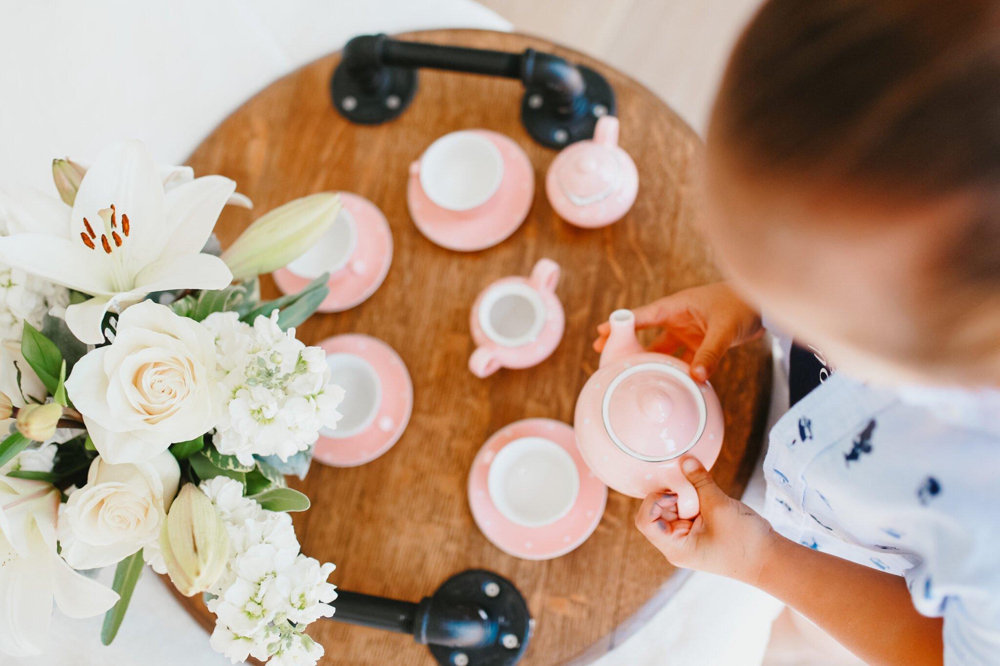 child with tea set