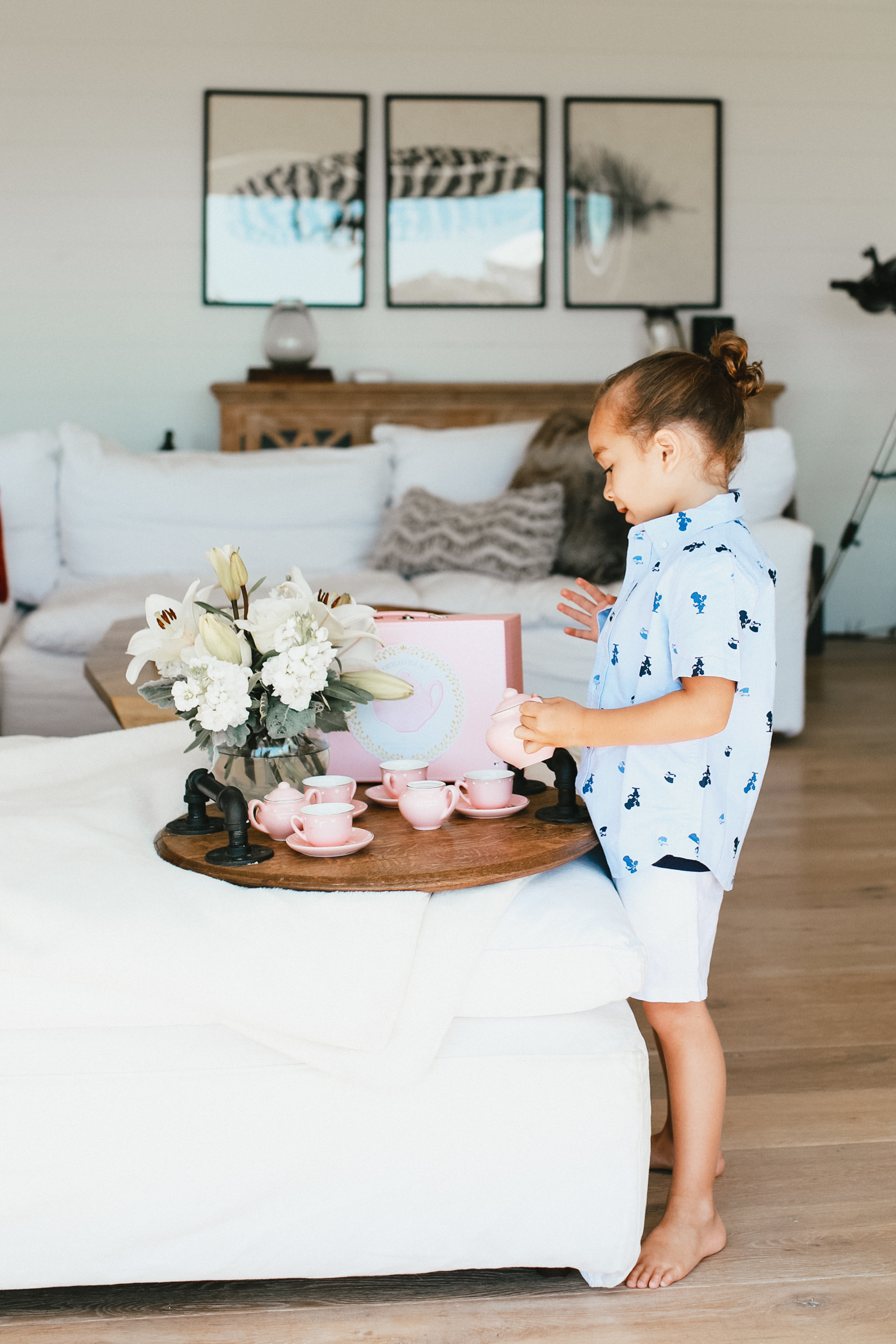 child playing with tea set