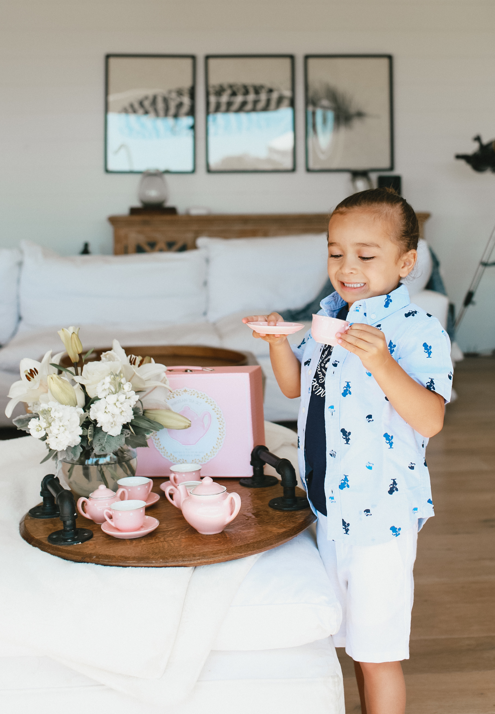 child holding teacup