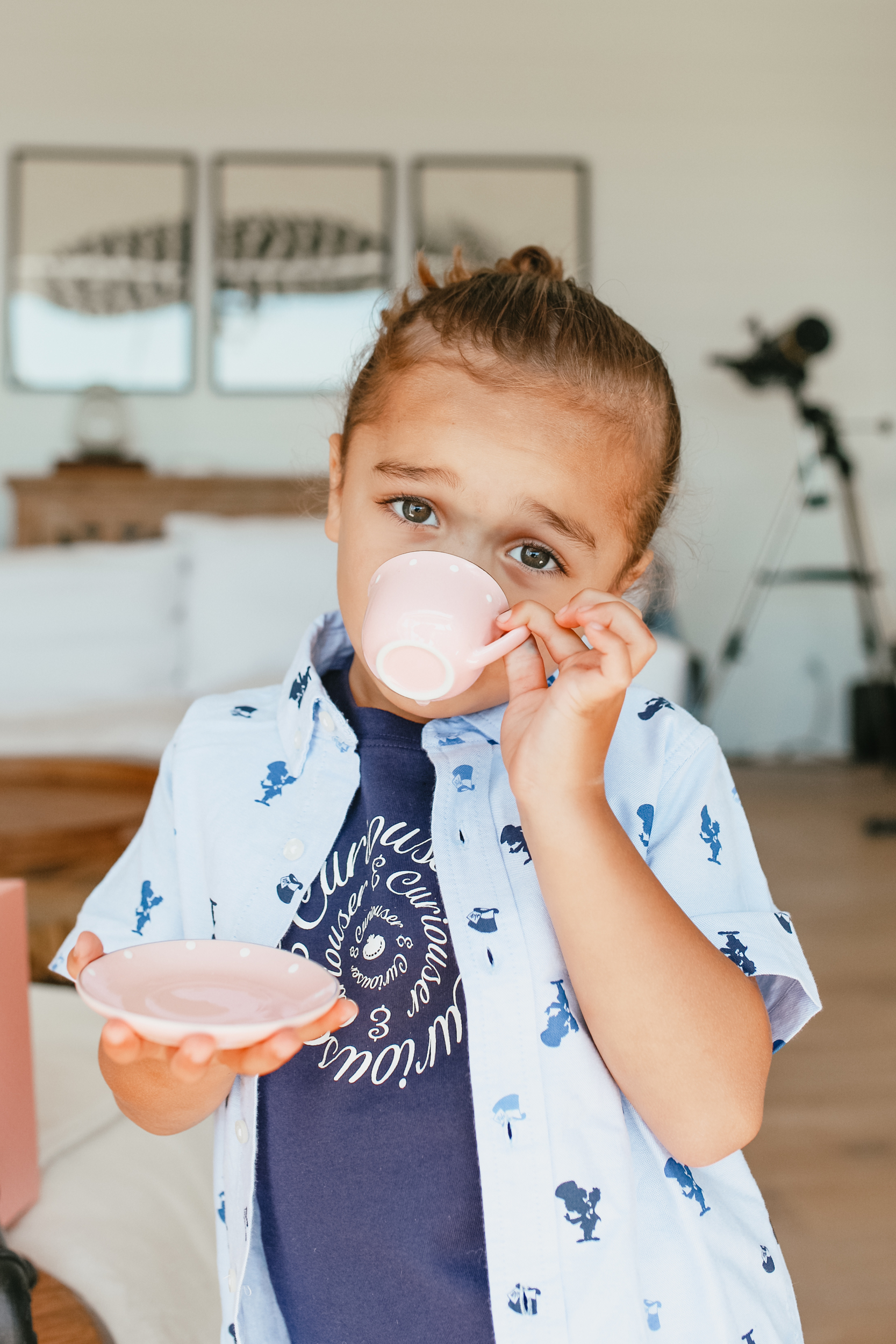 boy sipping from teacup