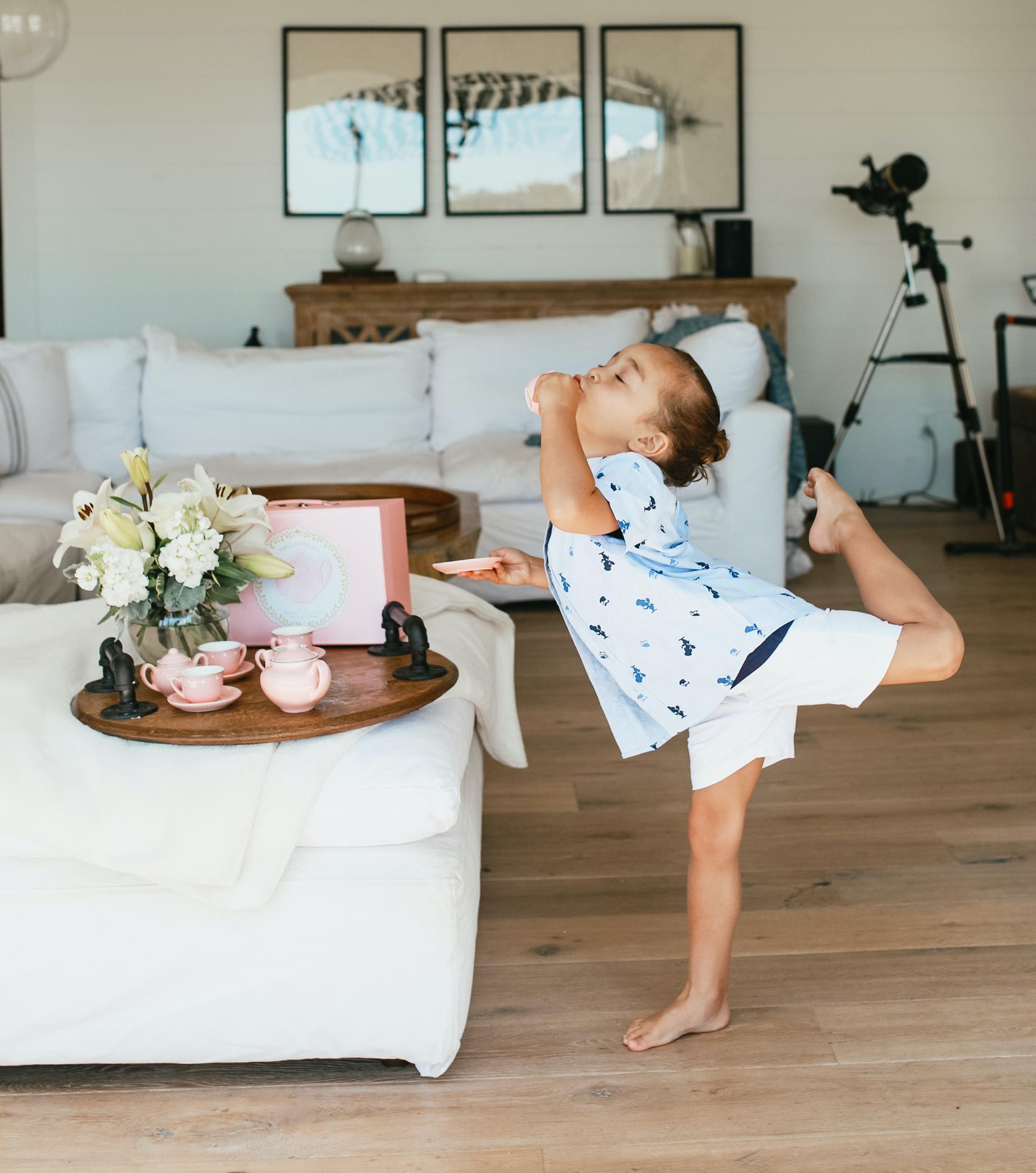 boy dancing with tea set