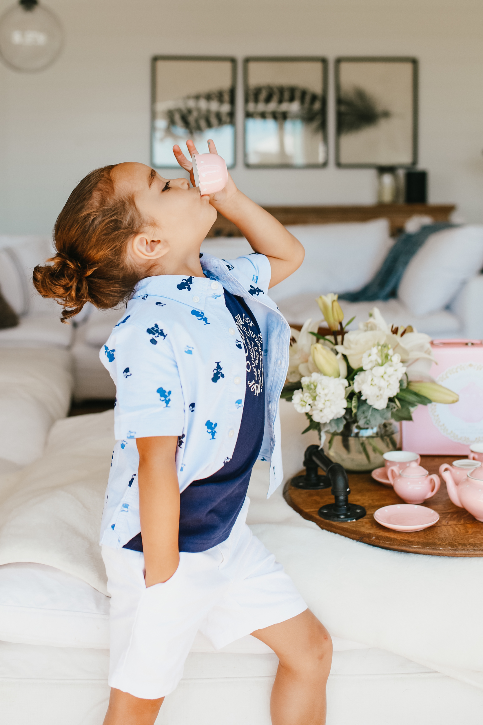 boy drinking from a teacup