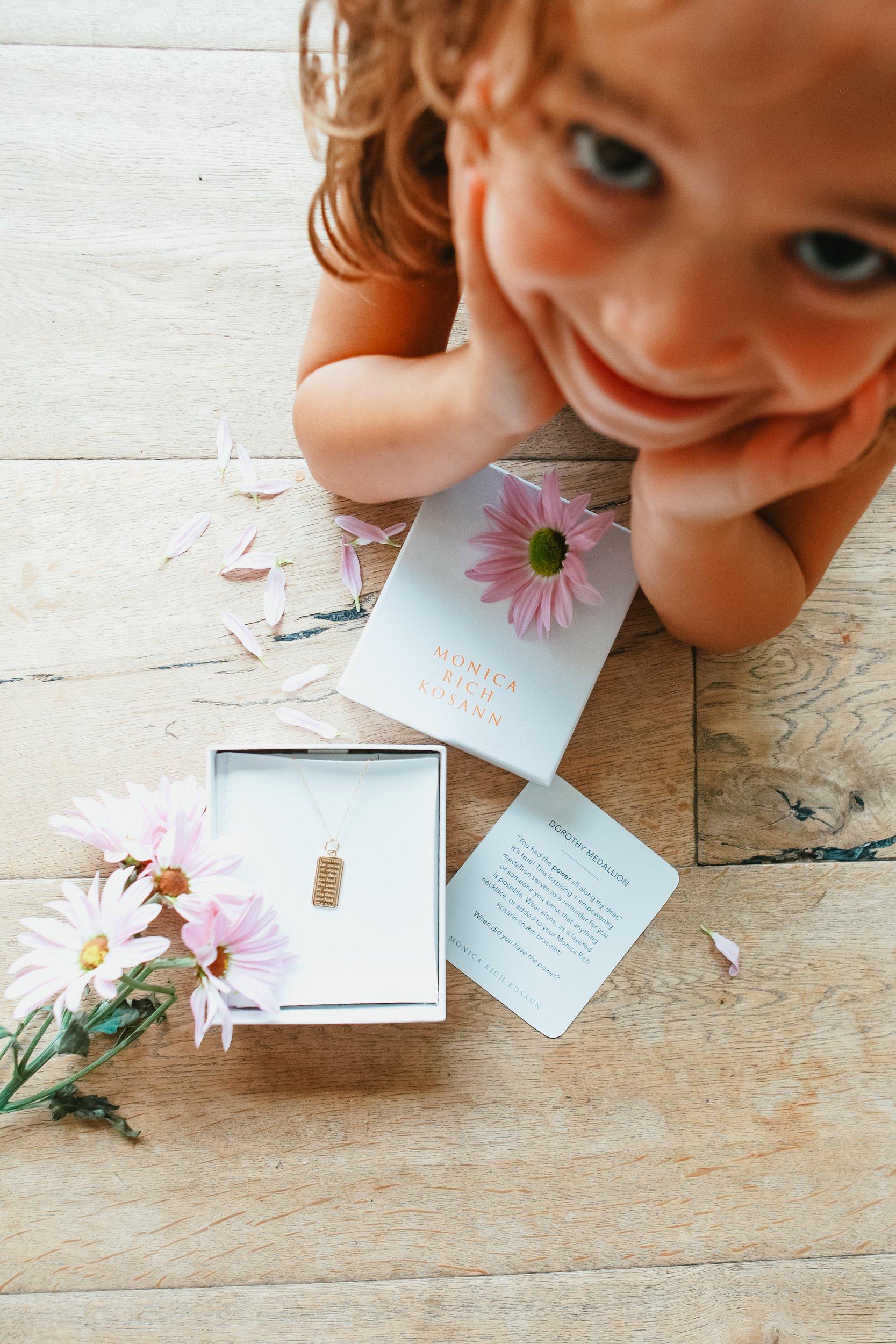 child with jewelry giftbox