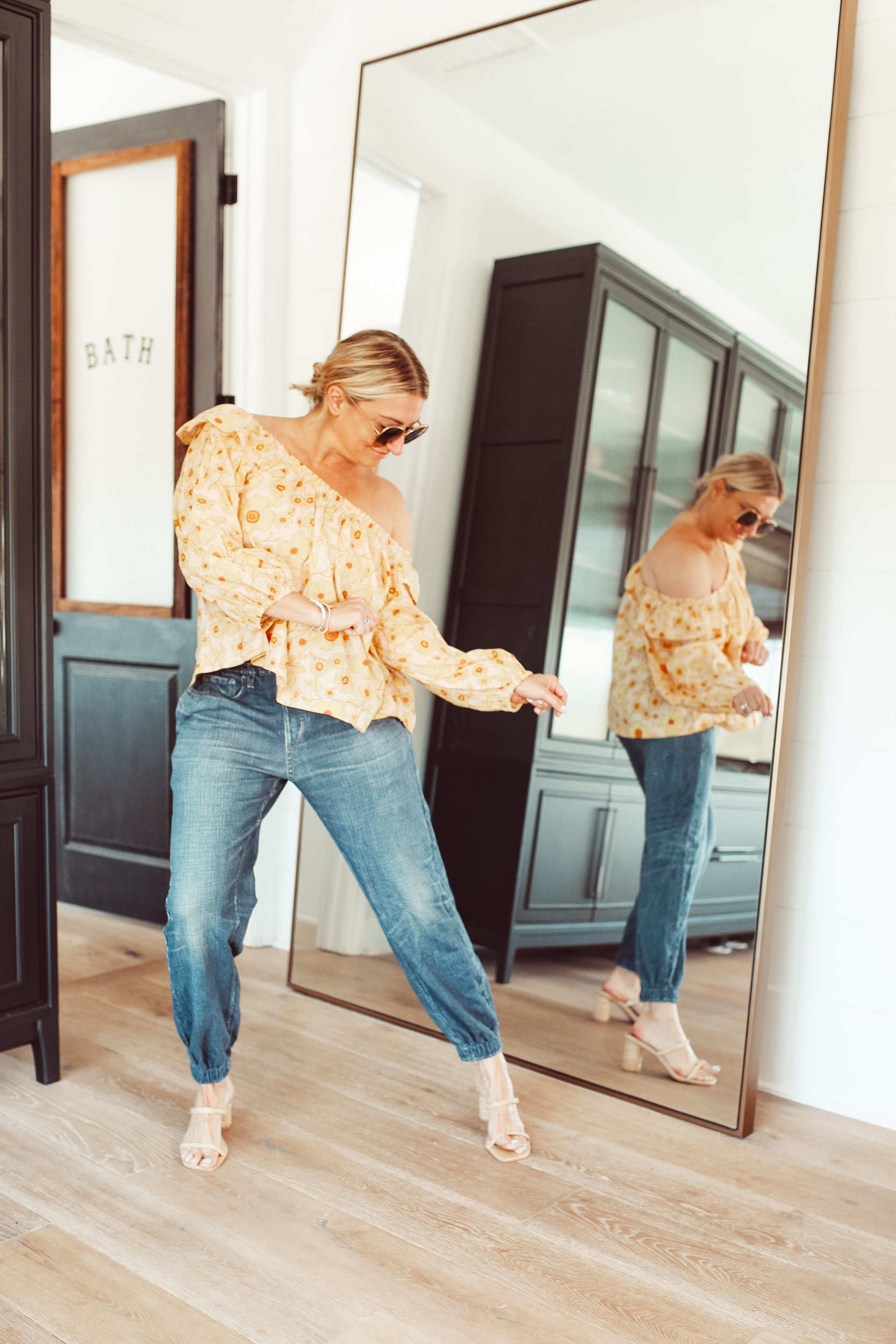 woman dancing by mirror