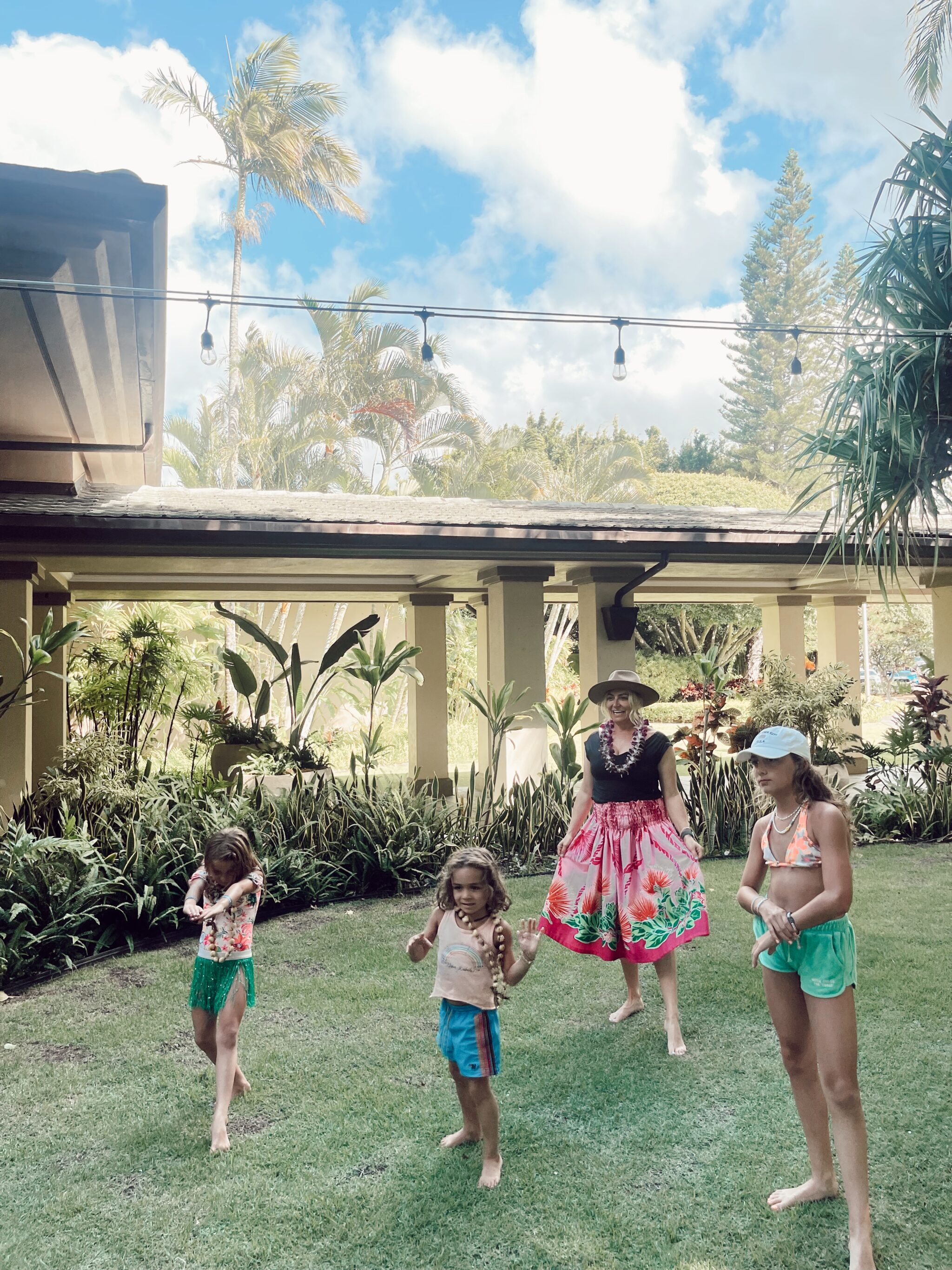 family playing outdoors in maui