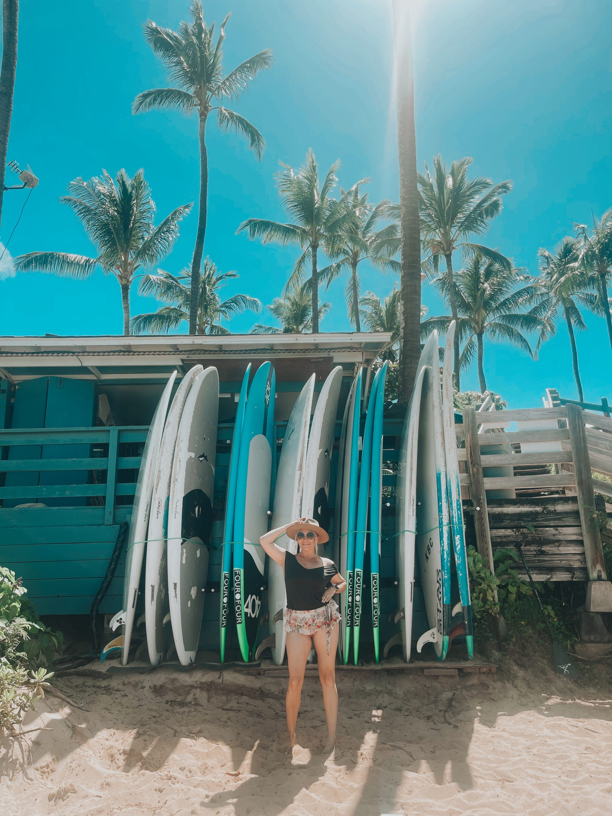 woman by surfboards
