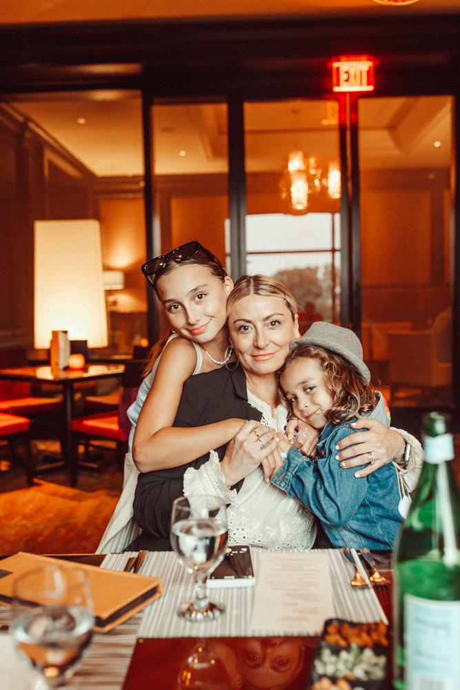 mom hugging her kids in restaurant