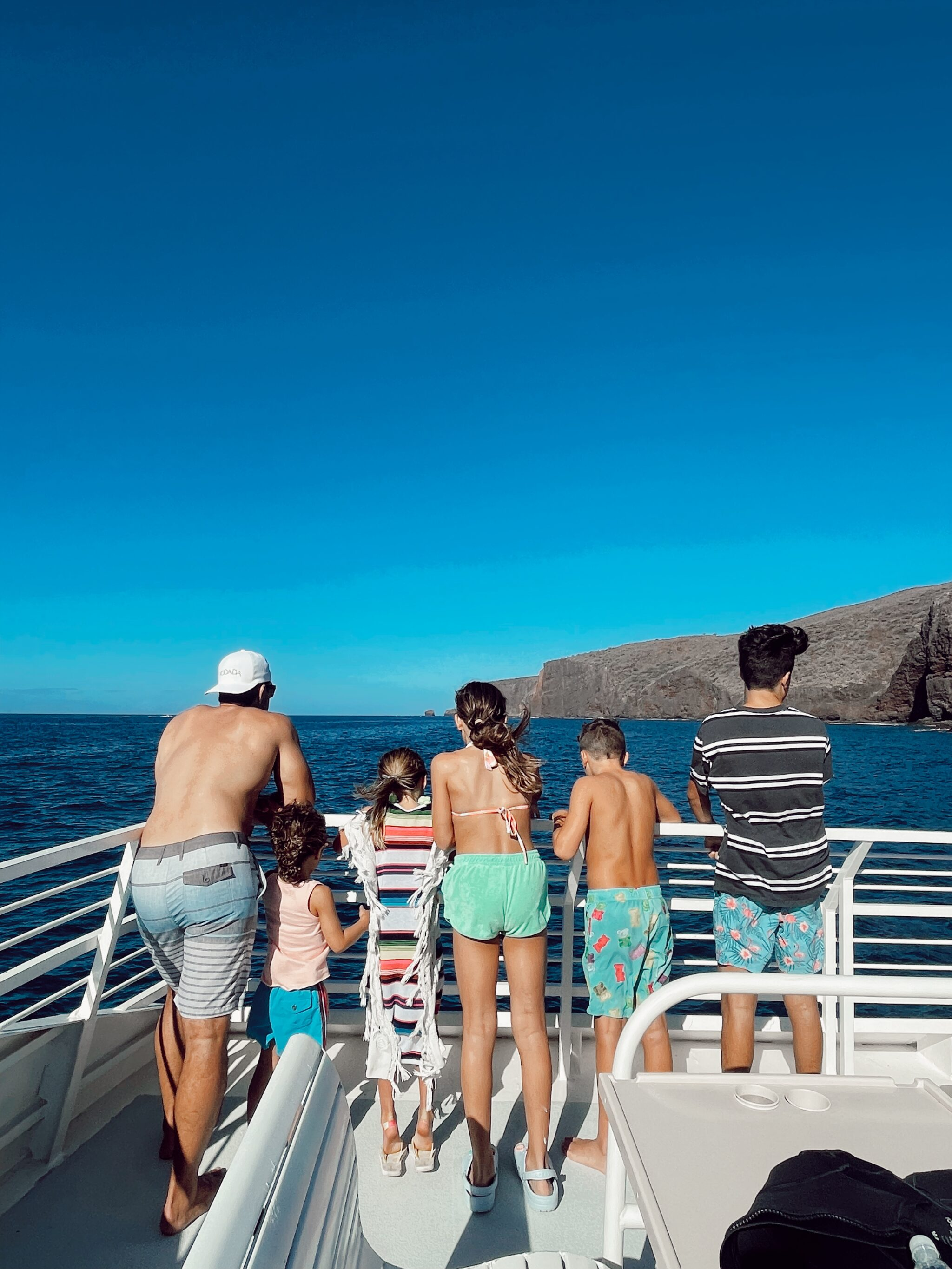 family on boat in maui
