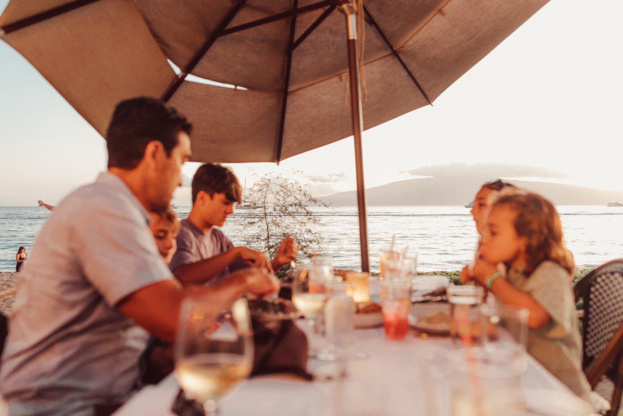 family dining at beach