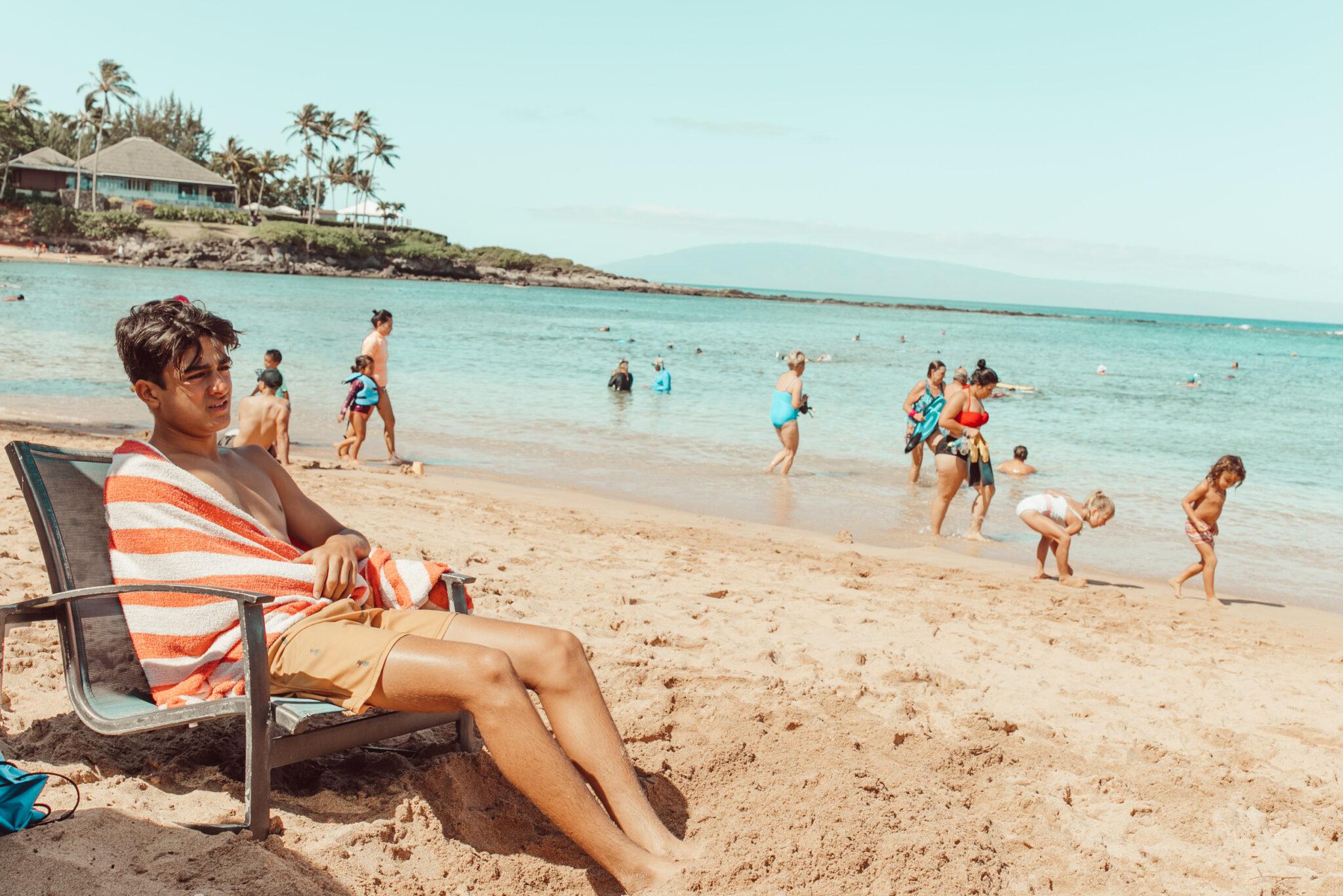 boy on beach in maui