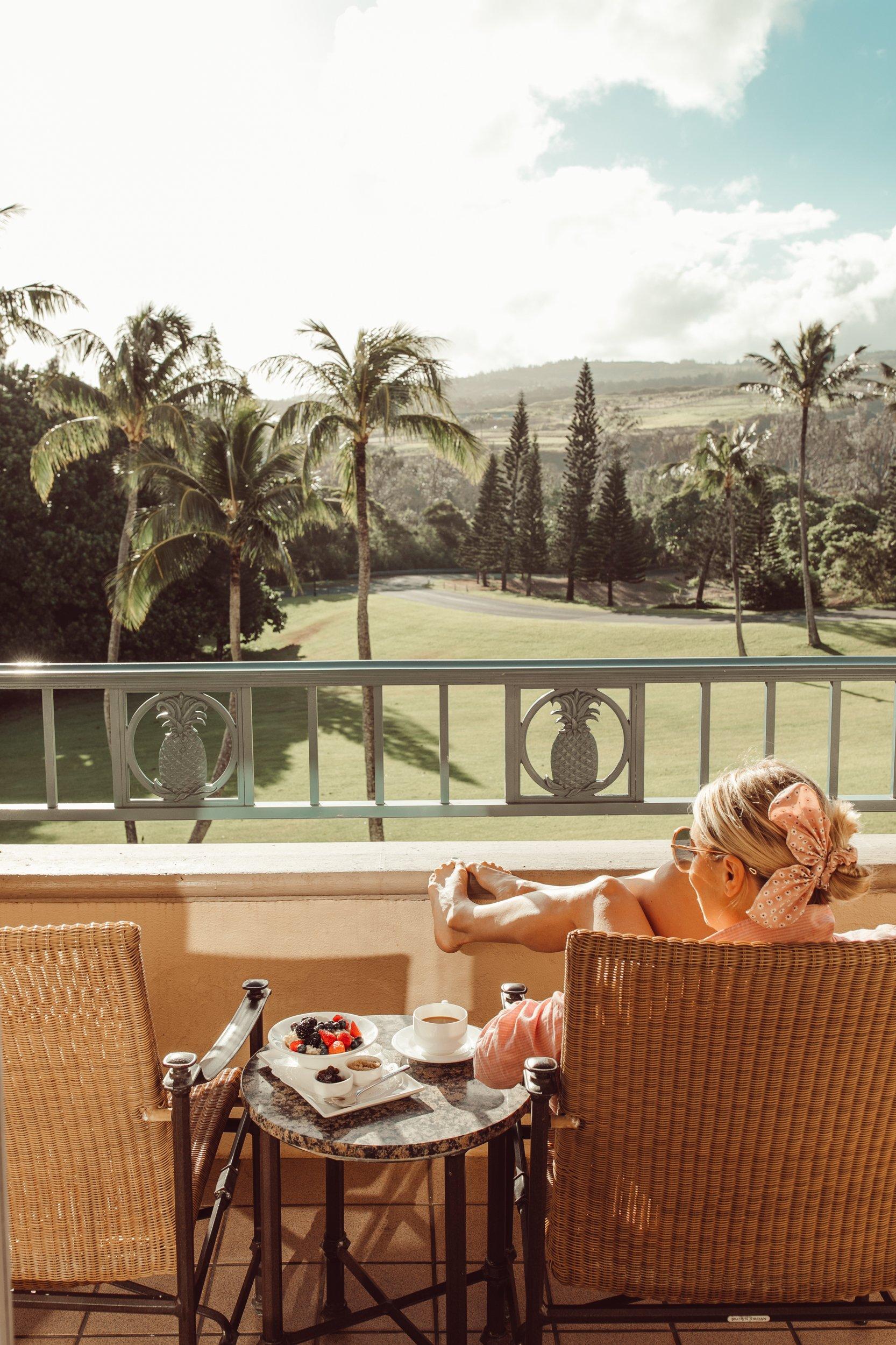 woman sunning on balcony in maui