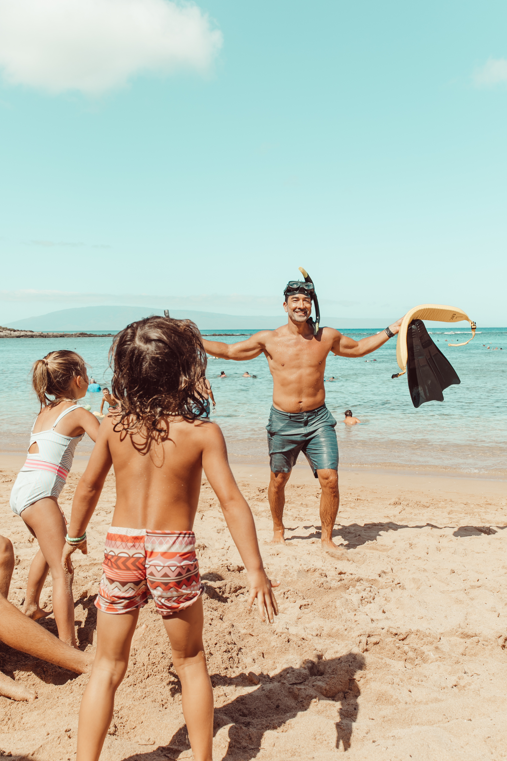 dads with kids at the beach