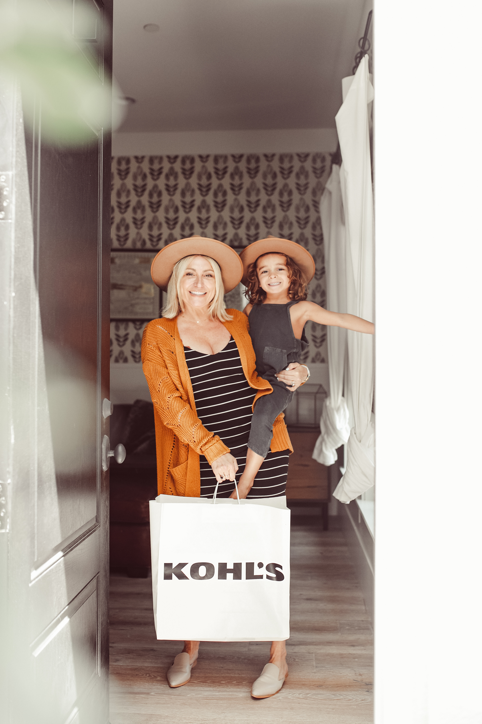 mom and son with kohl's shopping bag