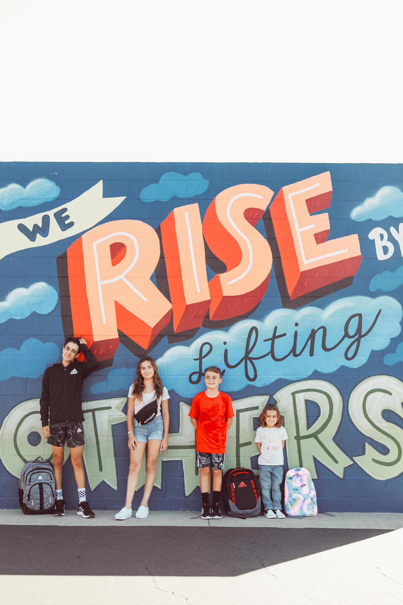 siblings by mural