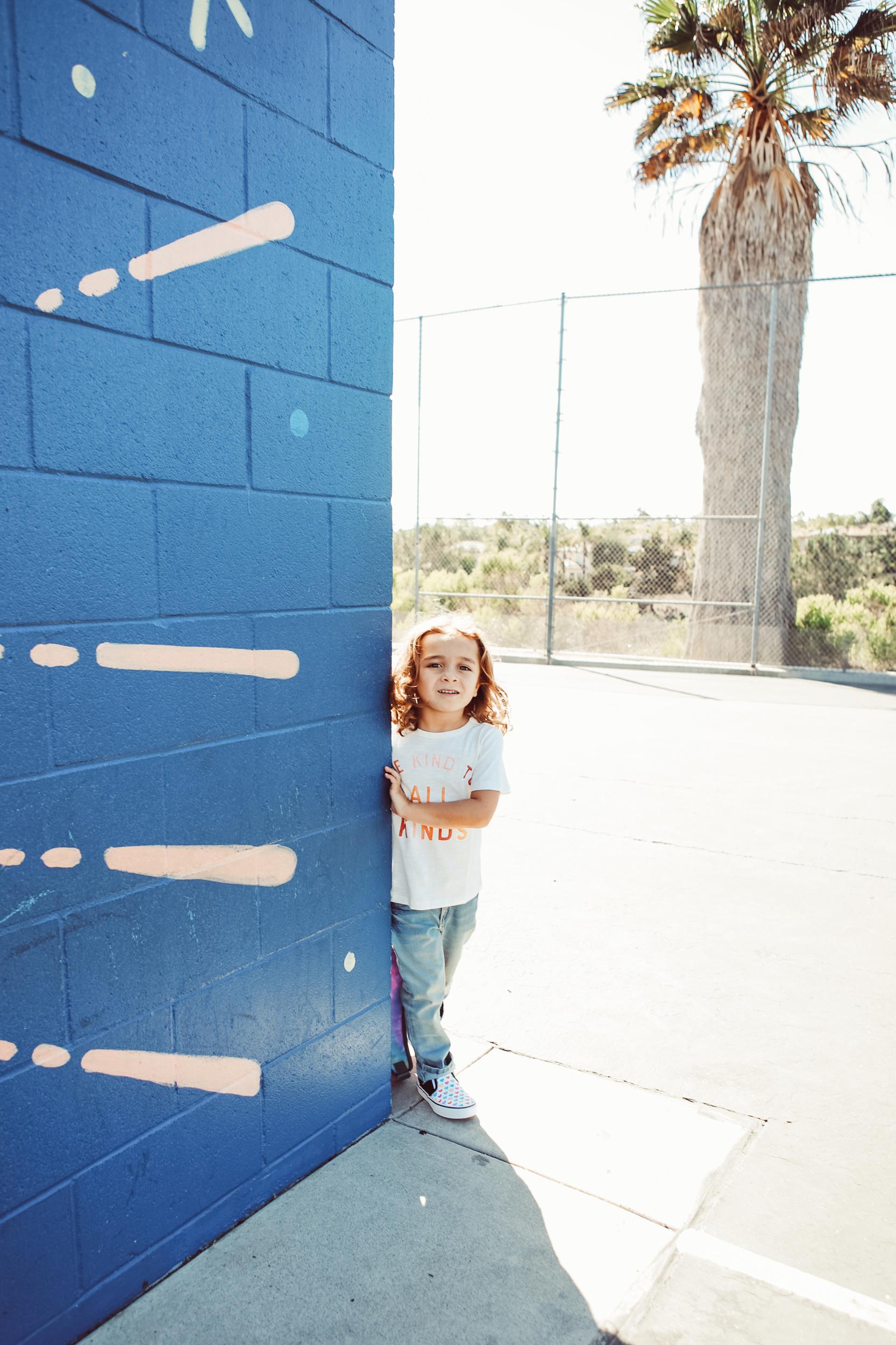kid behind corner