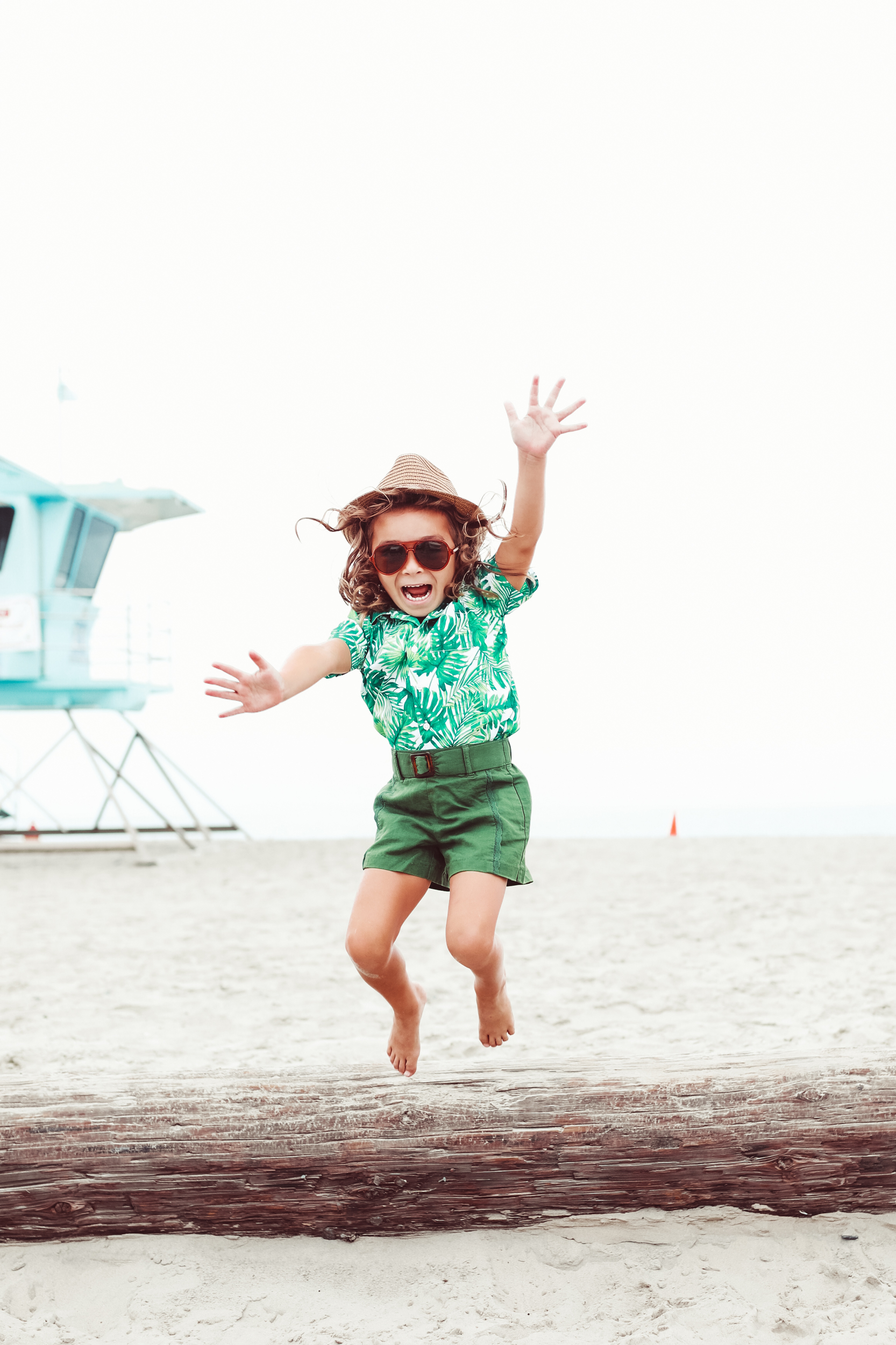 boy jumping in the sand